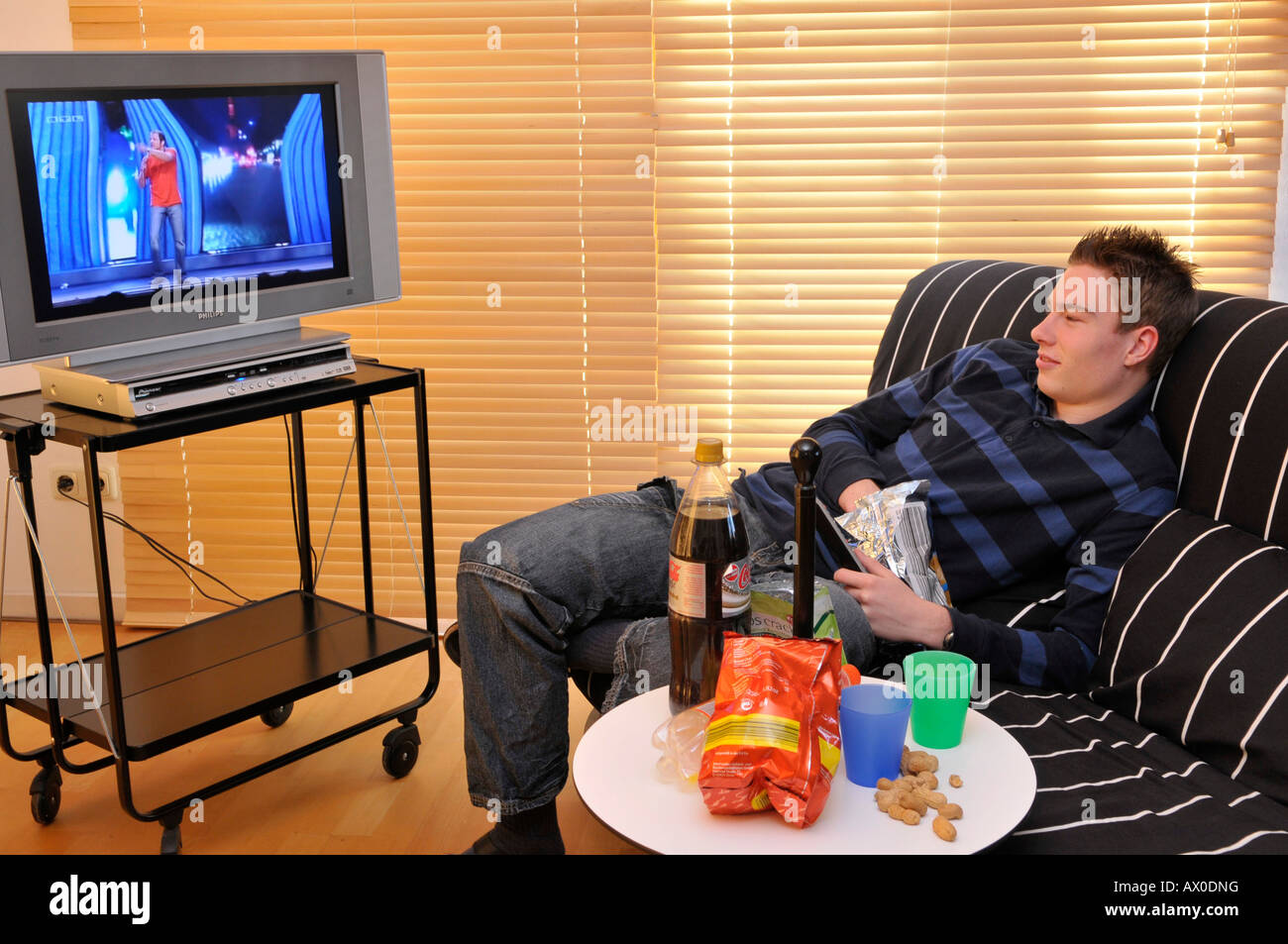 Teenager Sitting On Couch Watching Tv Stock Photo 16688139 Alamy