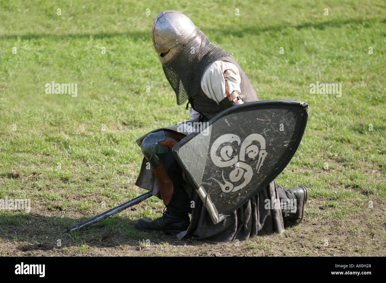 The black Knight is kneeling in the medieval tournament in Visby in Gotland Sweden - Stock Image