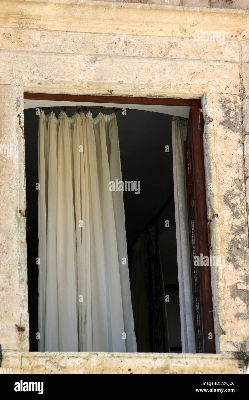White Curtain drape in window - Stock Image