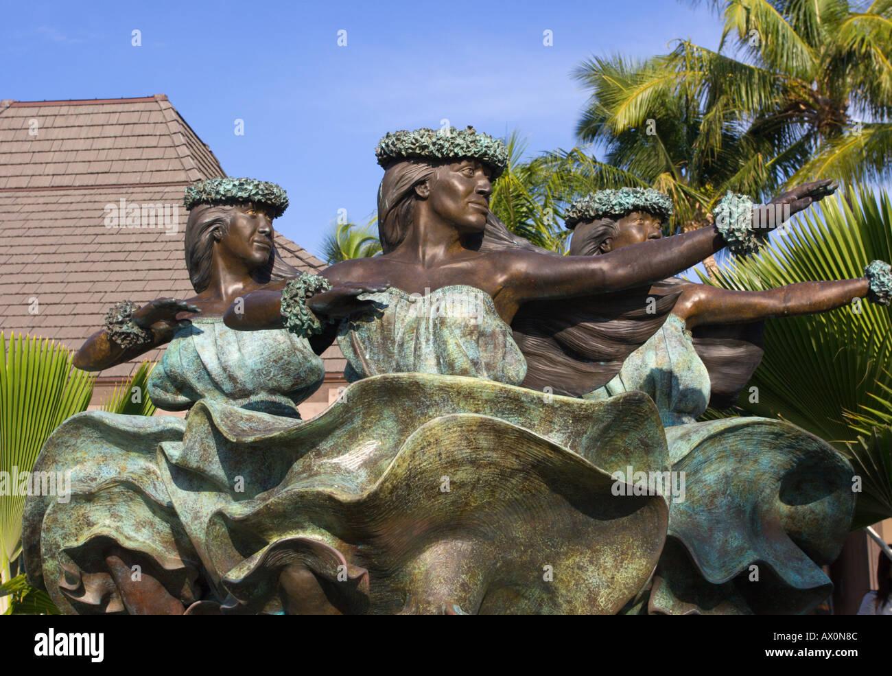 Lovely bronze statue of Hawaiian dancing trio at Keahole Kona International Airport Big Island Hawaii - Stock Image