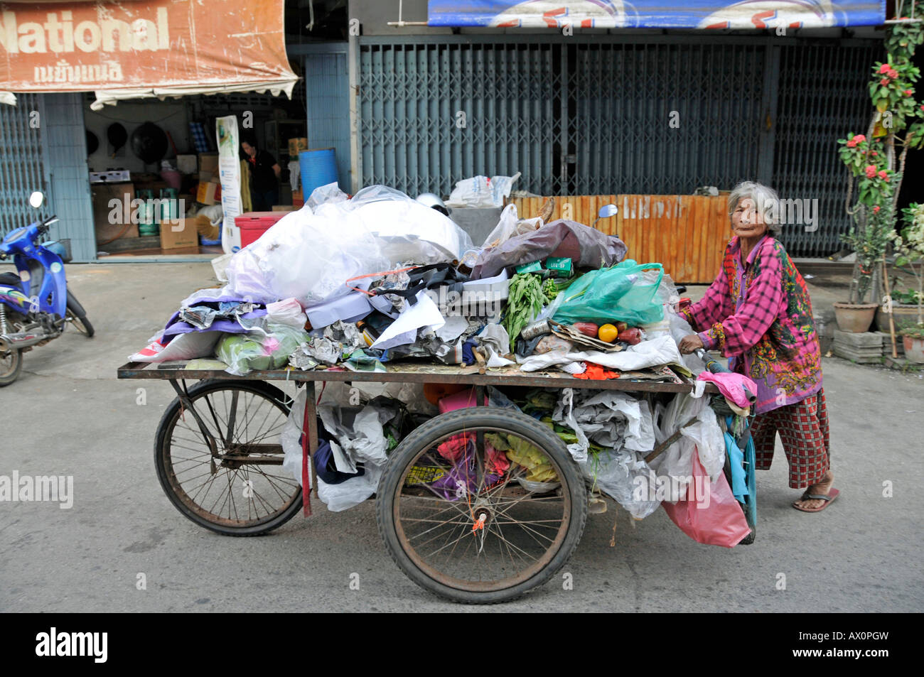 Old-age poverty: woman collecting garbage in Sukhothai, Thailand, Southeast Asia, Asia - Stock Image