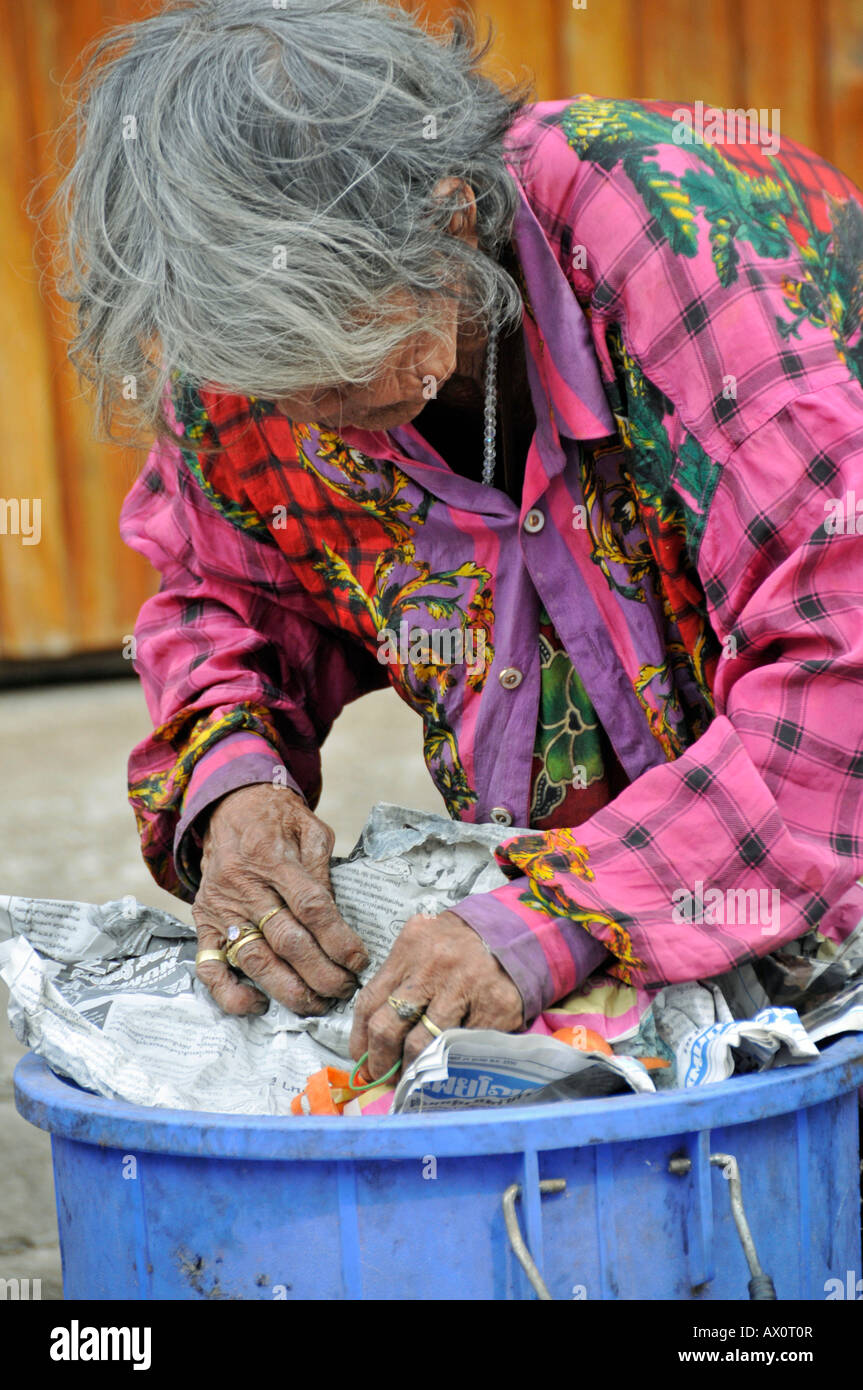 Old-age poverty: woman sorting through trash in Sukhothai, Thailand, Southeast Asia, Asia - Stock Image