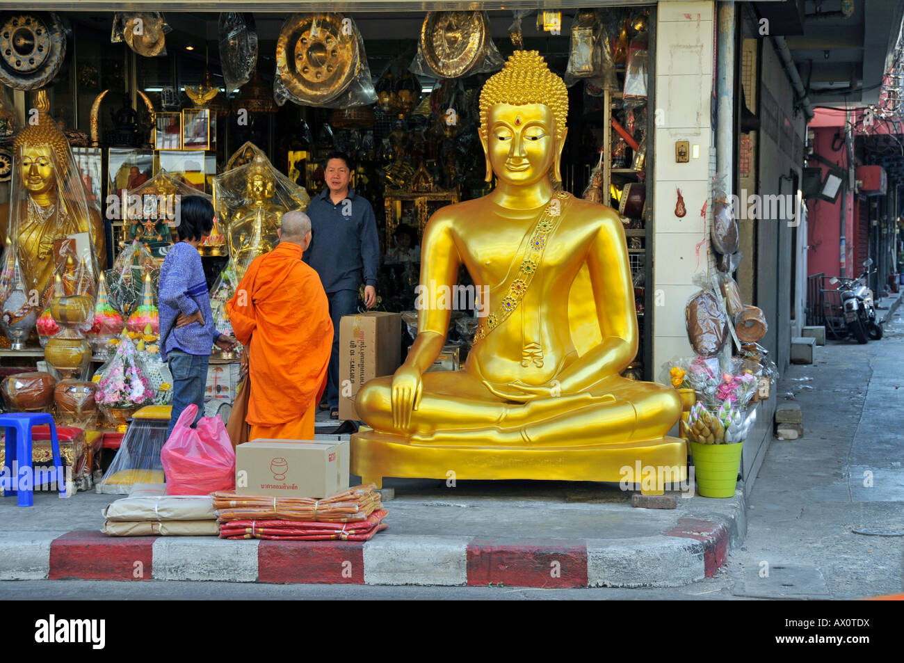 Buddha statues and other devotional objects for sale along Bamrung Muang Road, Bangkok, Thailand, Southeast Asia - Stock Image