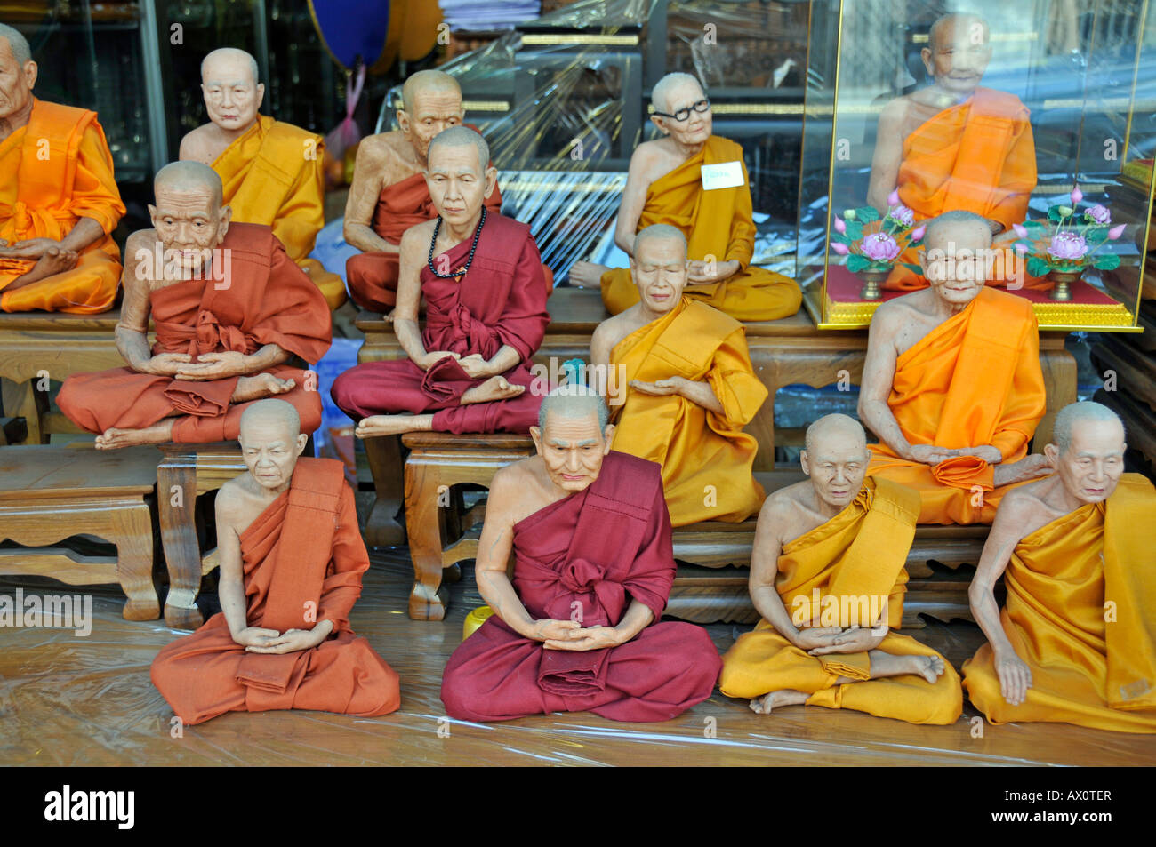 Monk figurines and other devotional objects for sale along Bamrung Muang Road, Bangkok, Thailand, Southeast Asia - Stock Image