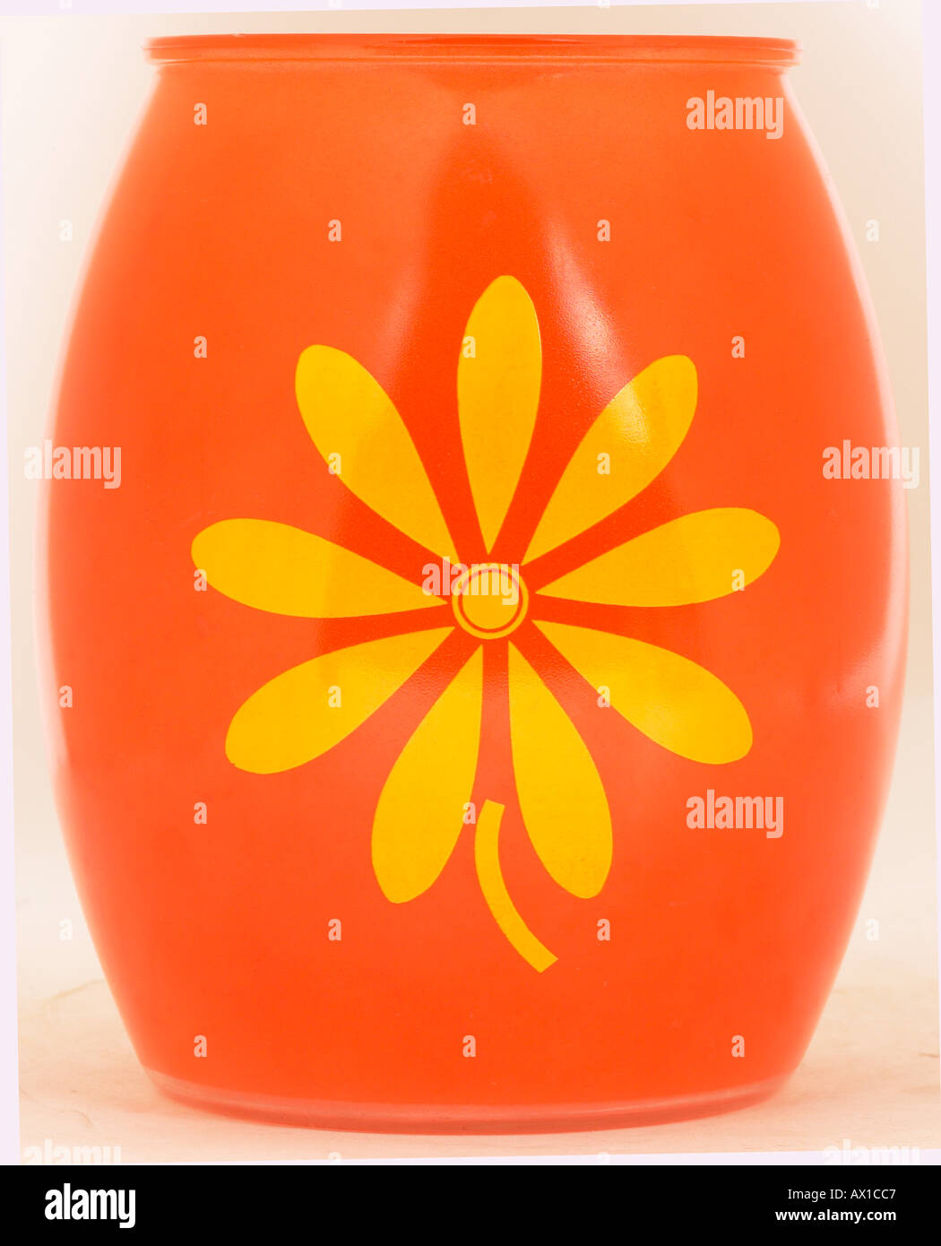 Orange glass vase with painted yellow flower L3 - Stock Image