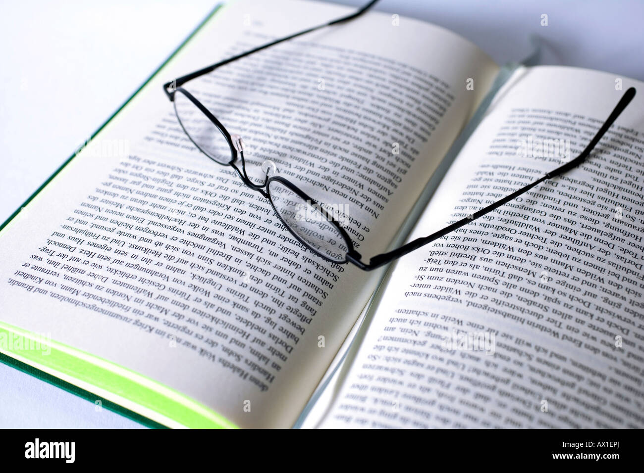 reading glasses on open book stock photos reading glasses on open