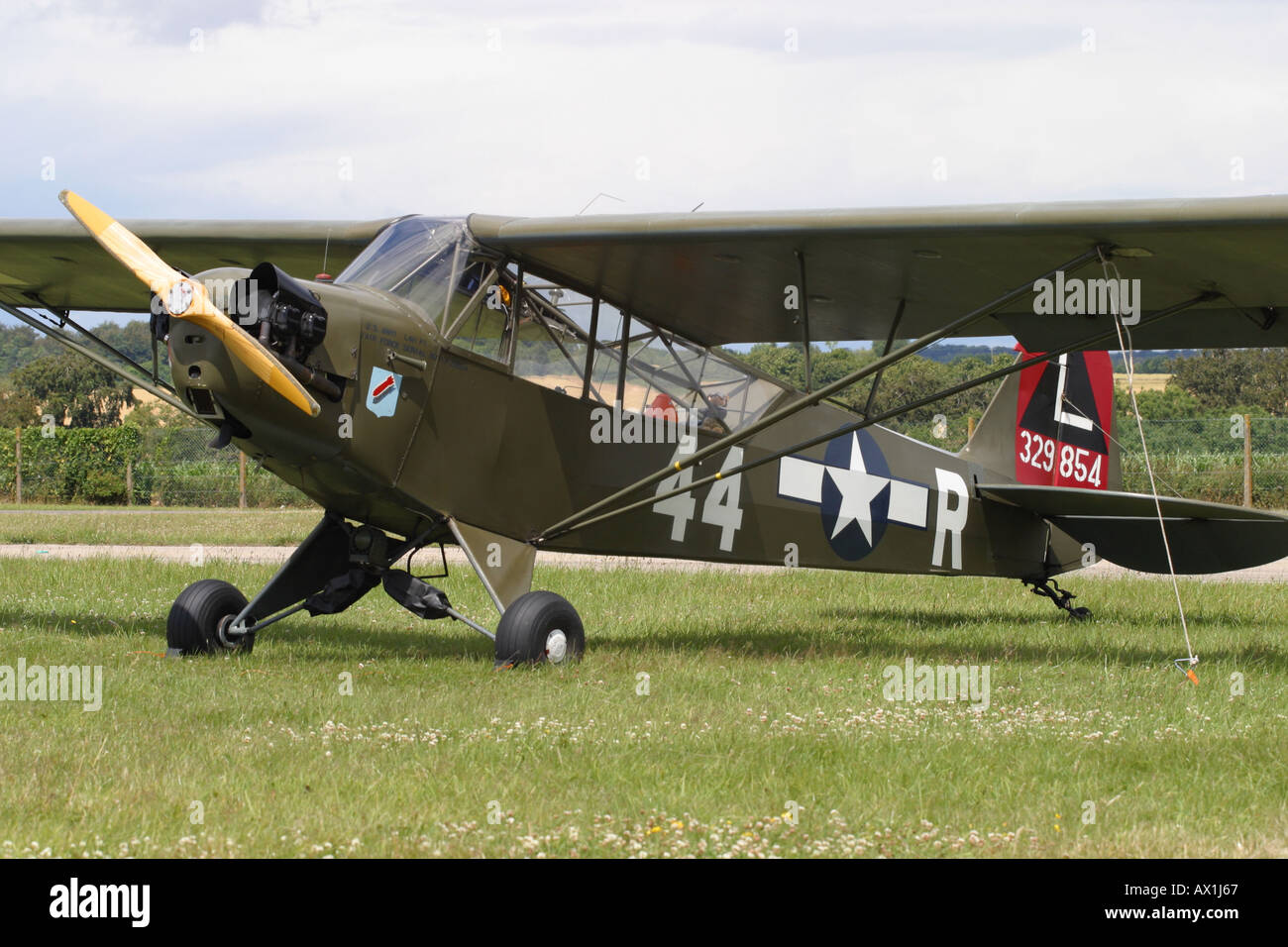 Piper Cub L-4 vintage warbird World War 2 US Army observation spotter plane Stock Photo