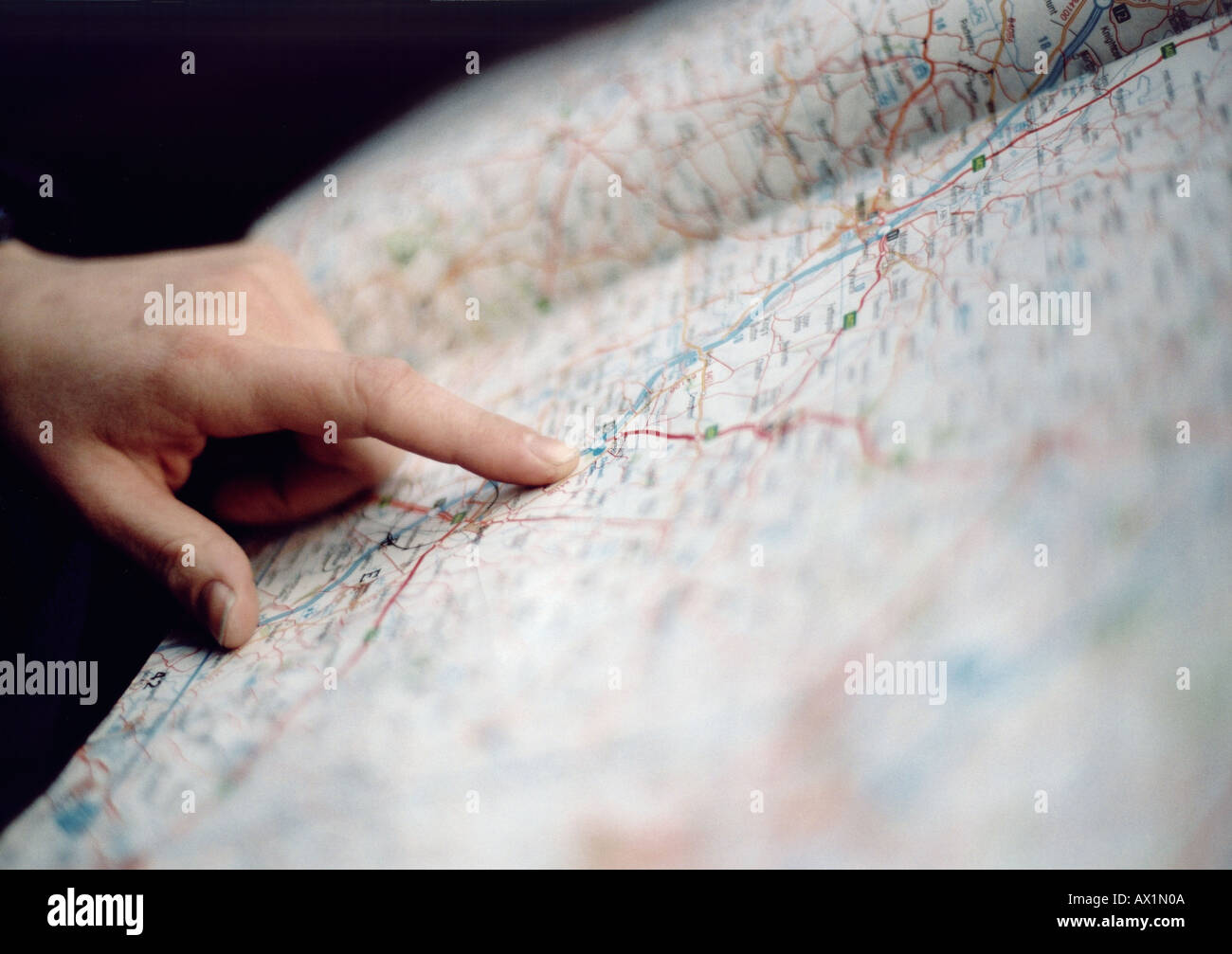 Finger pointing on a map - Stock Image