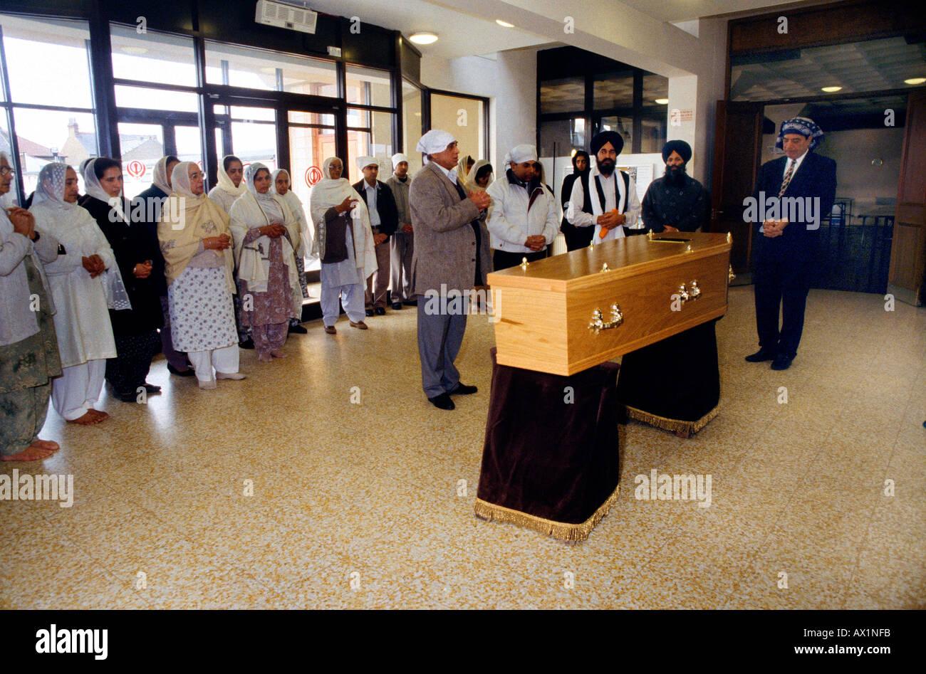 Sikh Funeral Coffin In Gurdwara People Praying - Stock Image