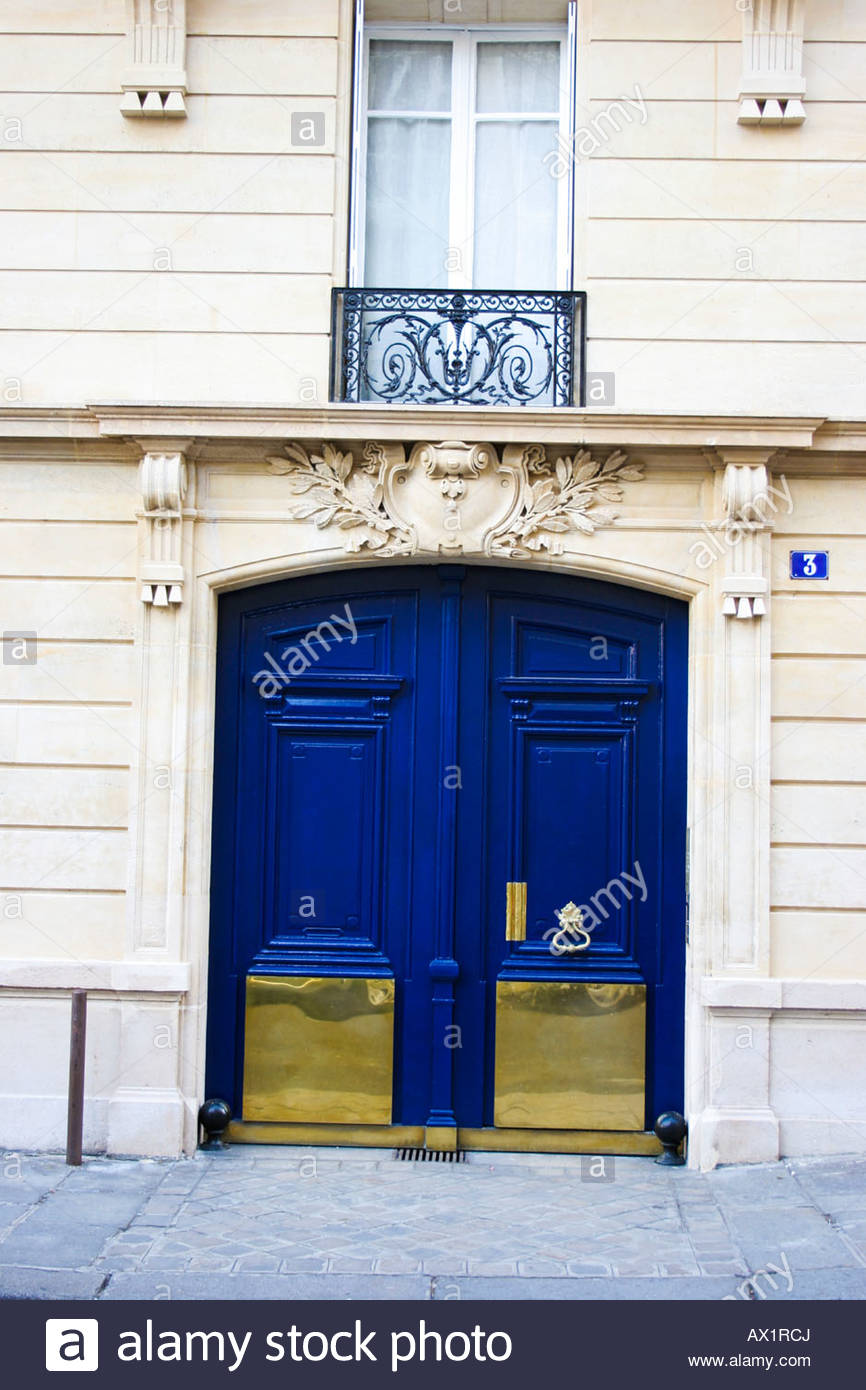 Blue door with metal panels and ornaments in Paris & Blue door with metal panels and ornaments in Paris Stock Photo ...