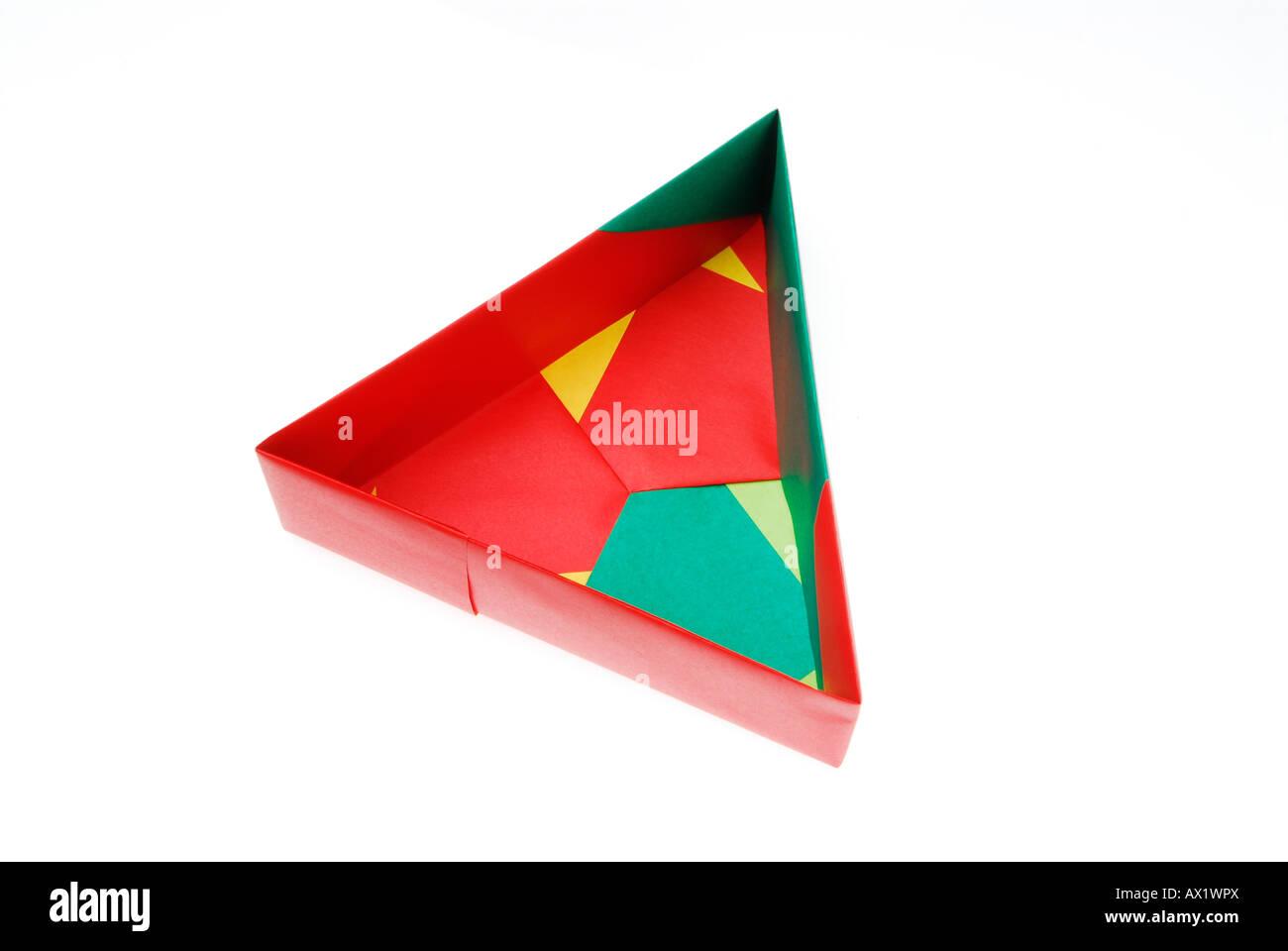 Origami folding, three-sided box - Stock Image
