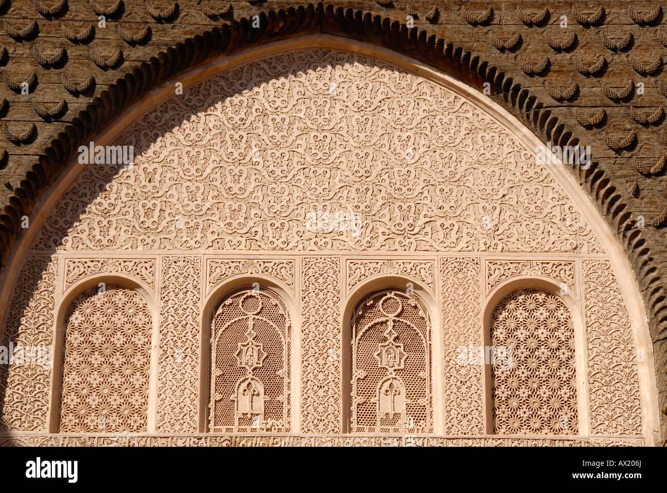 Oriental windows with fine stucco richly decorated Medersa Ali Ben Youssef medina Marrakech Morocco Stock Photo