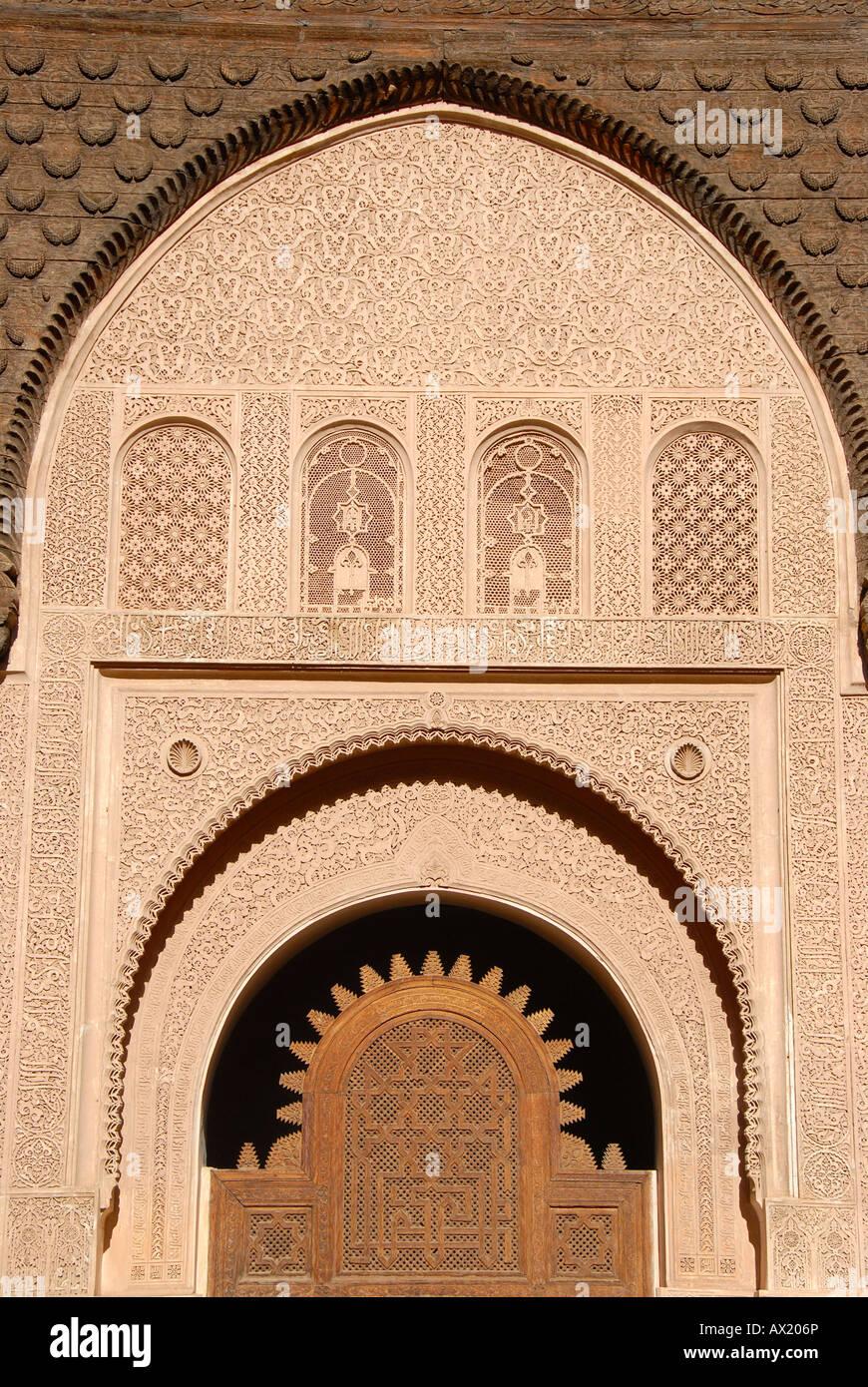 Oriental portal made of cedar wood with fine stucco richly decorated Medersa Ali Ben Youssef medina Marrakech Morocco Stock Photo
