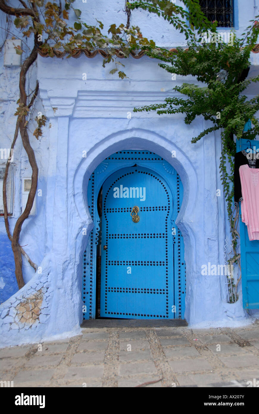 Luminous blue gate medina Chefchaouen Morocco - Stock Image