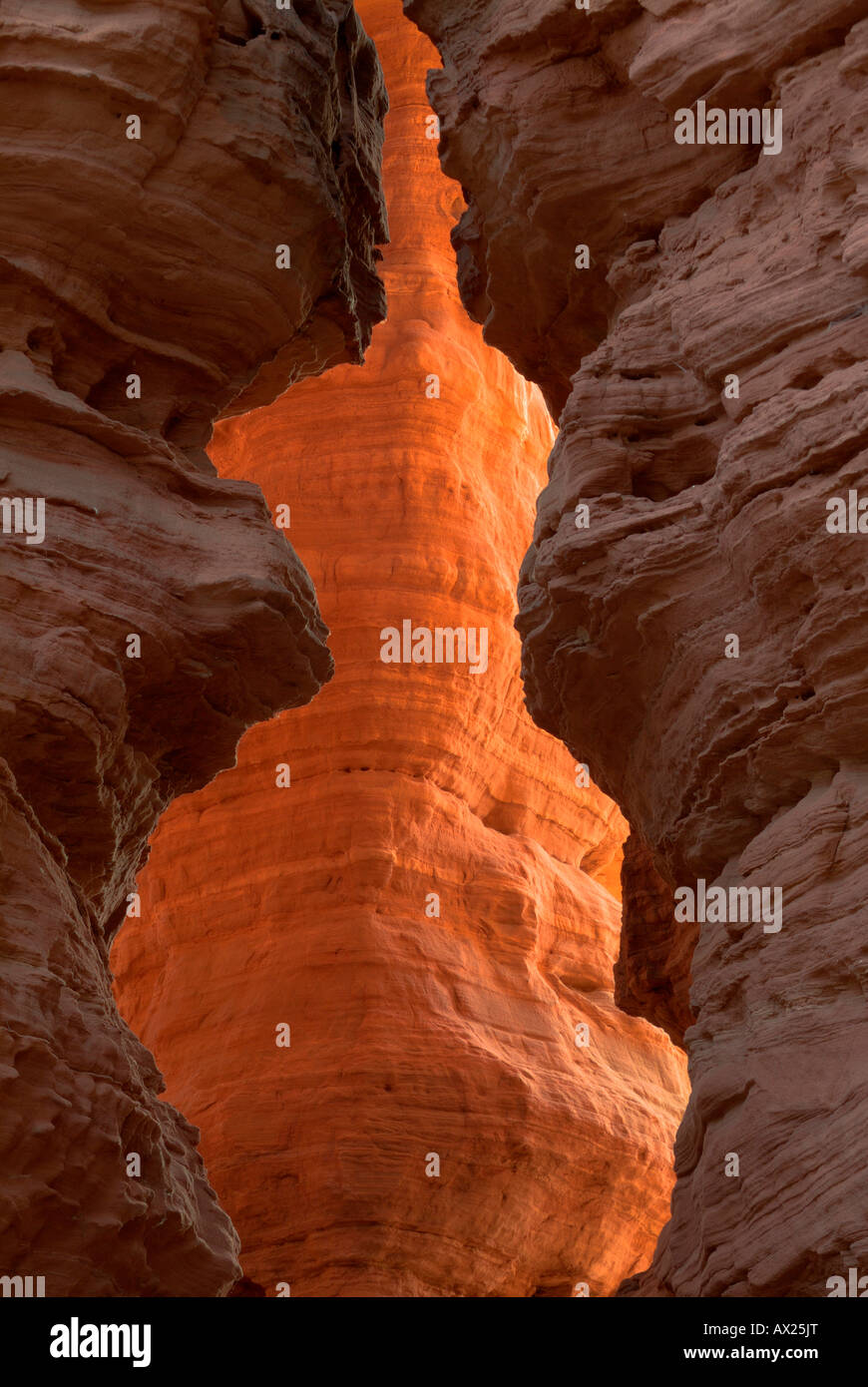 Rocks lit from behind by the setting sun, photographed through a crevasse, Altschlossfelsen rock formations, Pfaelzer - Stock Image