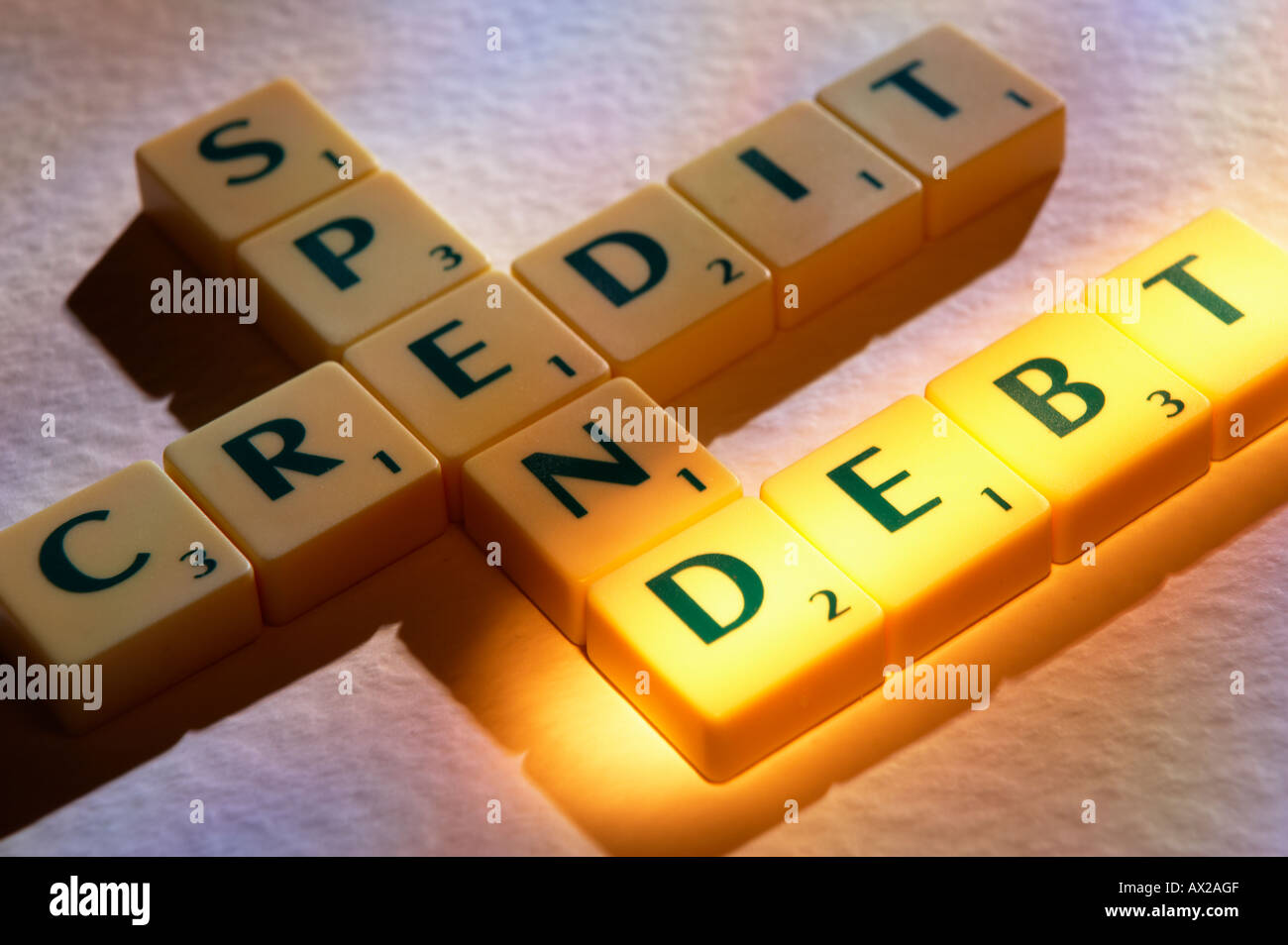 SCRABBLE BOARD GAME LETTERS SPELLING CREDIT SPEND DEBT - Stock Image