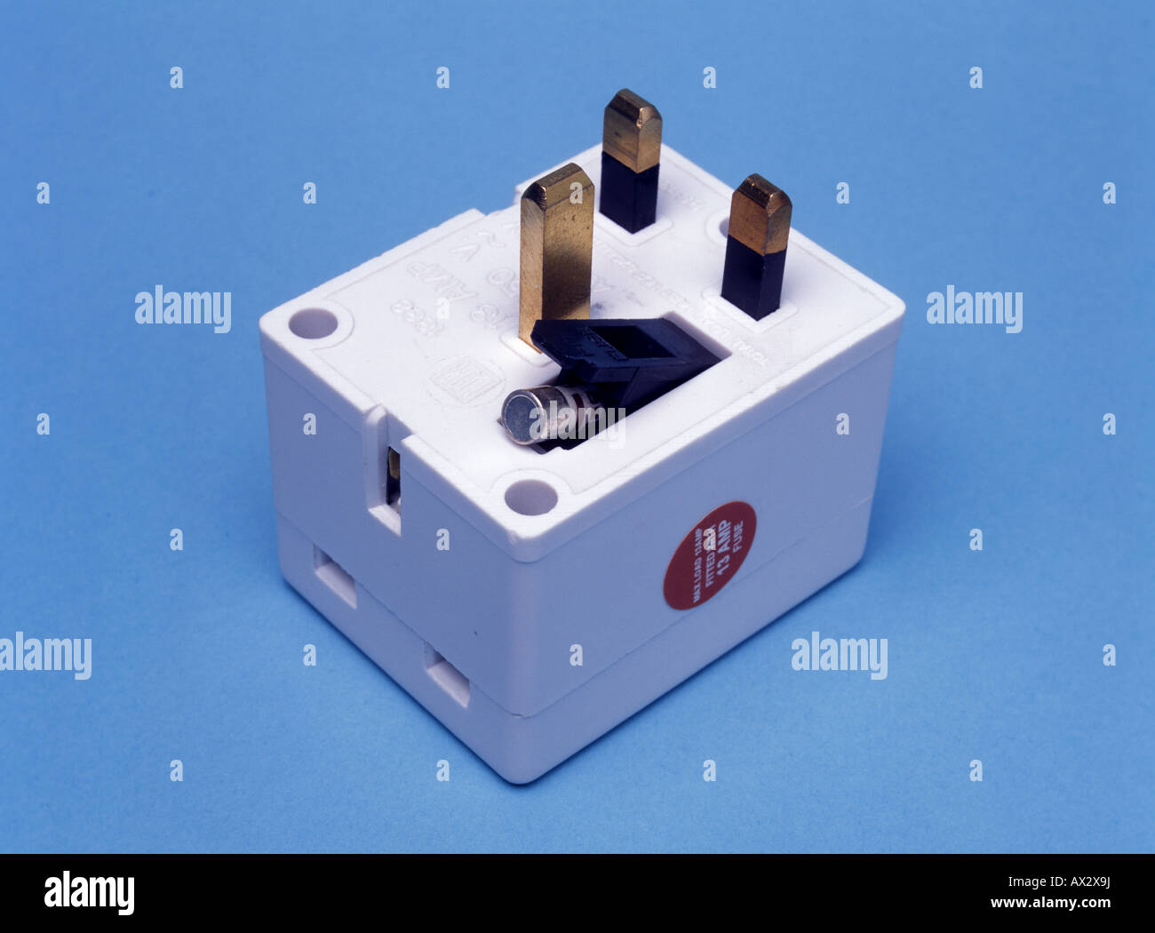 A 13 amp plug adaptor for use in UK - Stock Image