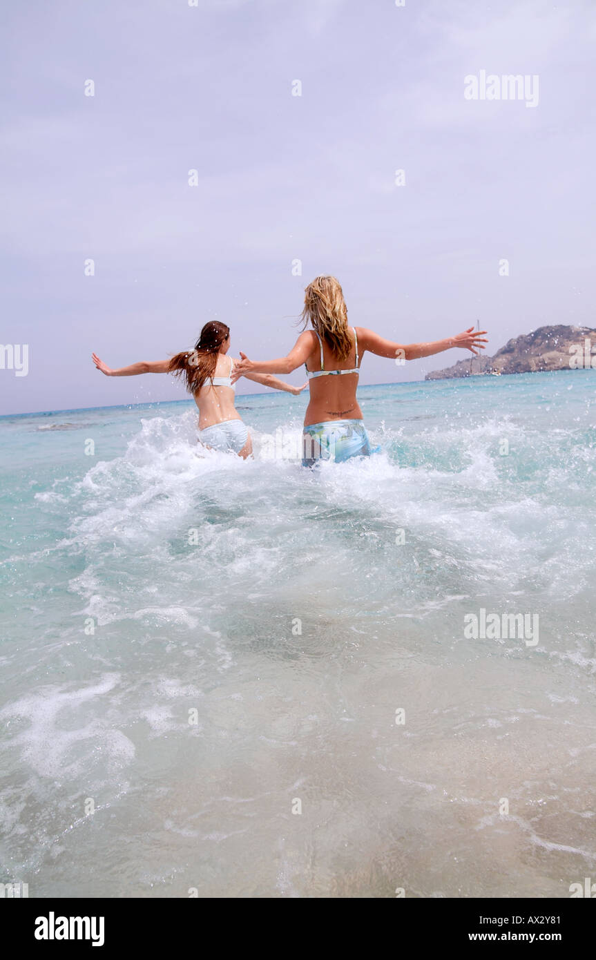 beach pureness beauty female women girls lifestyle people expressive leisure 20s ocean sea - Stock Image