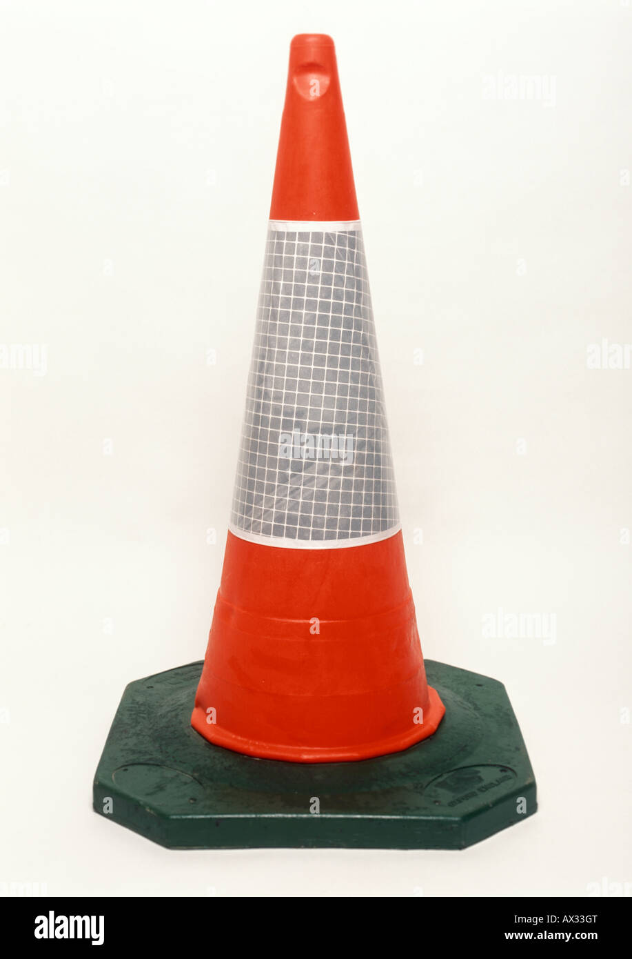 A road traffic cone on white background - Stock Image