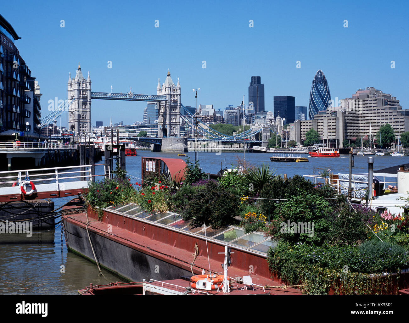 Houseboats moored in the Thames at Tower Bridge London Stock Photo