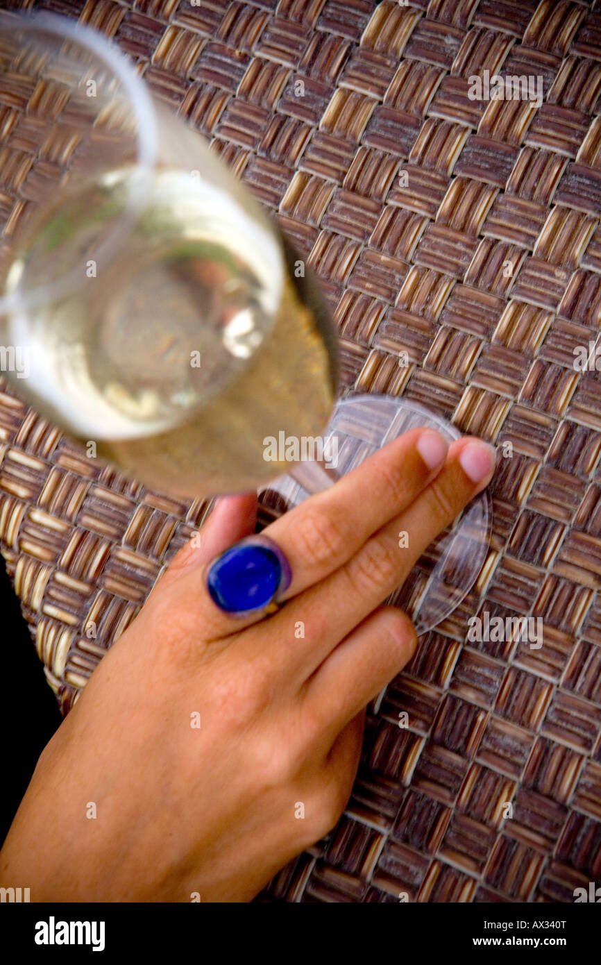 womans hand on a glass of prosecco - Stock Image
