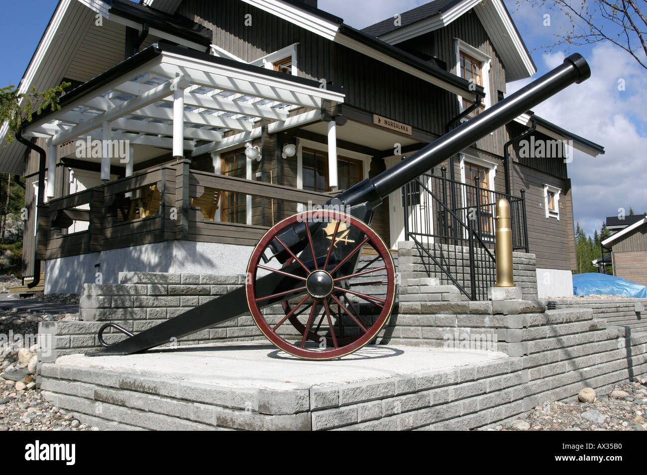 Decoration cannon in front of cottage Stock Photo