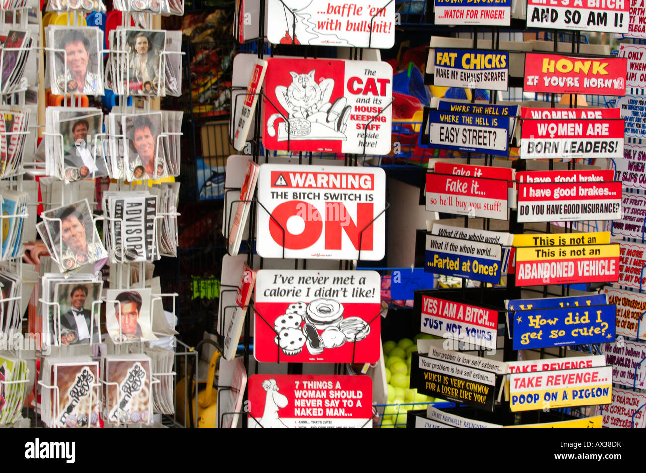 postcards and tacky comical gifts on sale at a seaside shop gift traders at the seaside in england - Stock Image