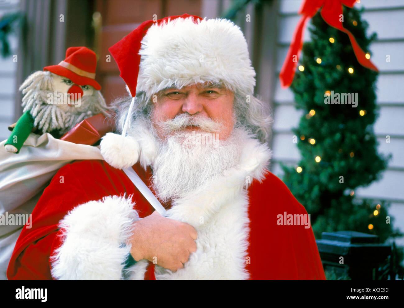 Christmas Santa Claus with small Santa - Stock Image