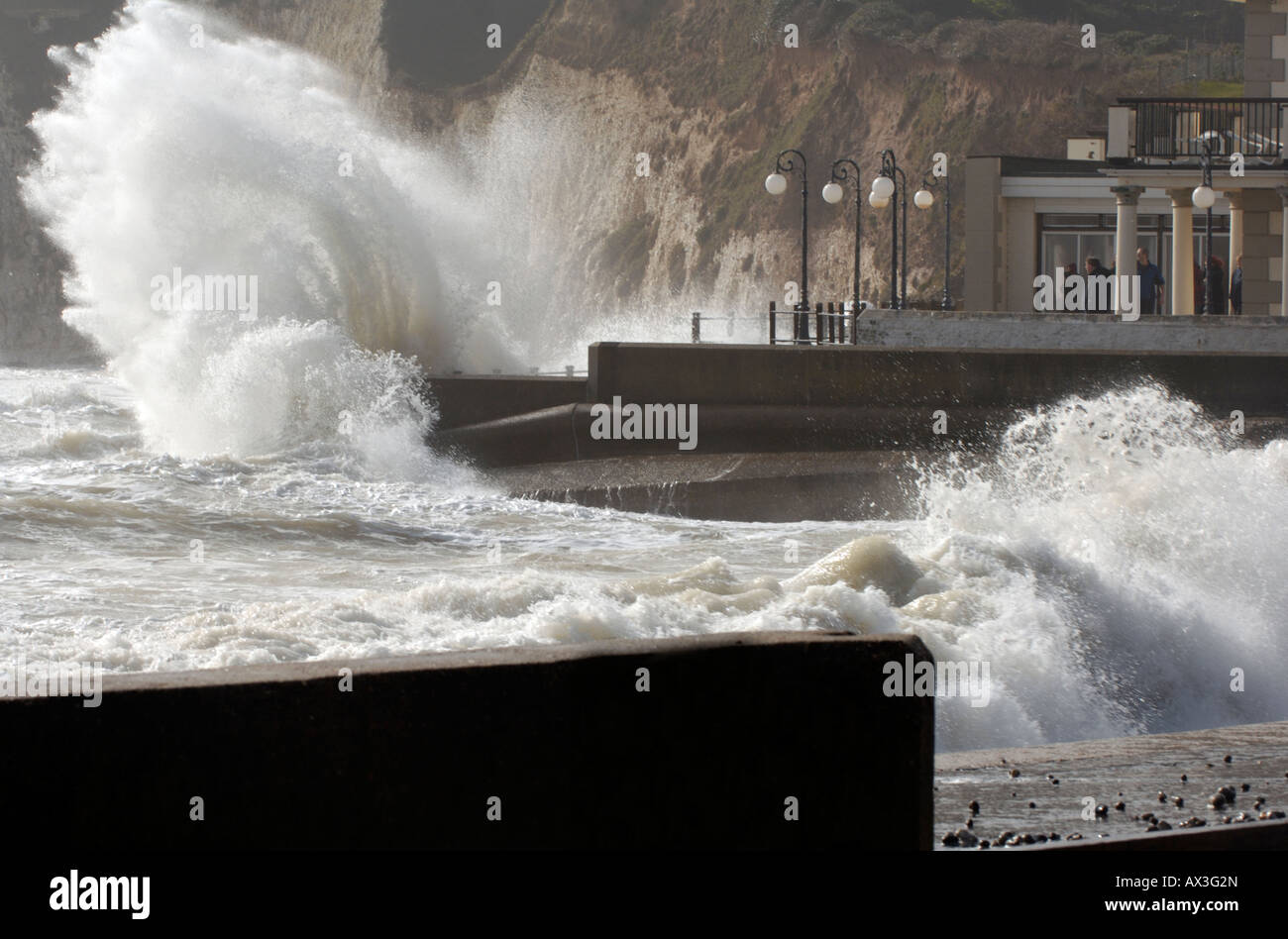 waves breaking over the sea wal in a storm at freshwater bay on the isle of wight. The sea smashing coastal defences - Stock Image