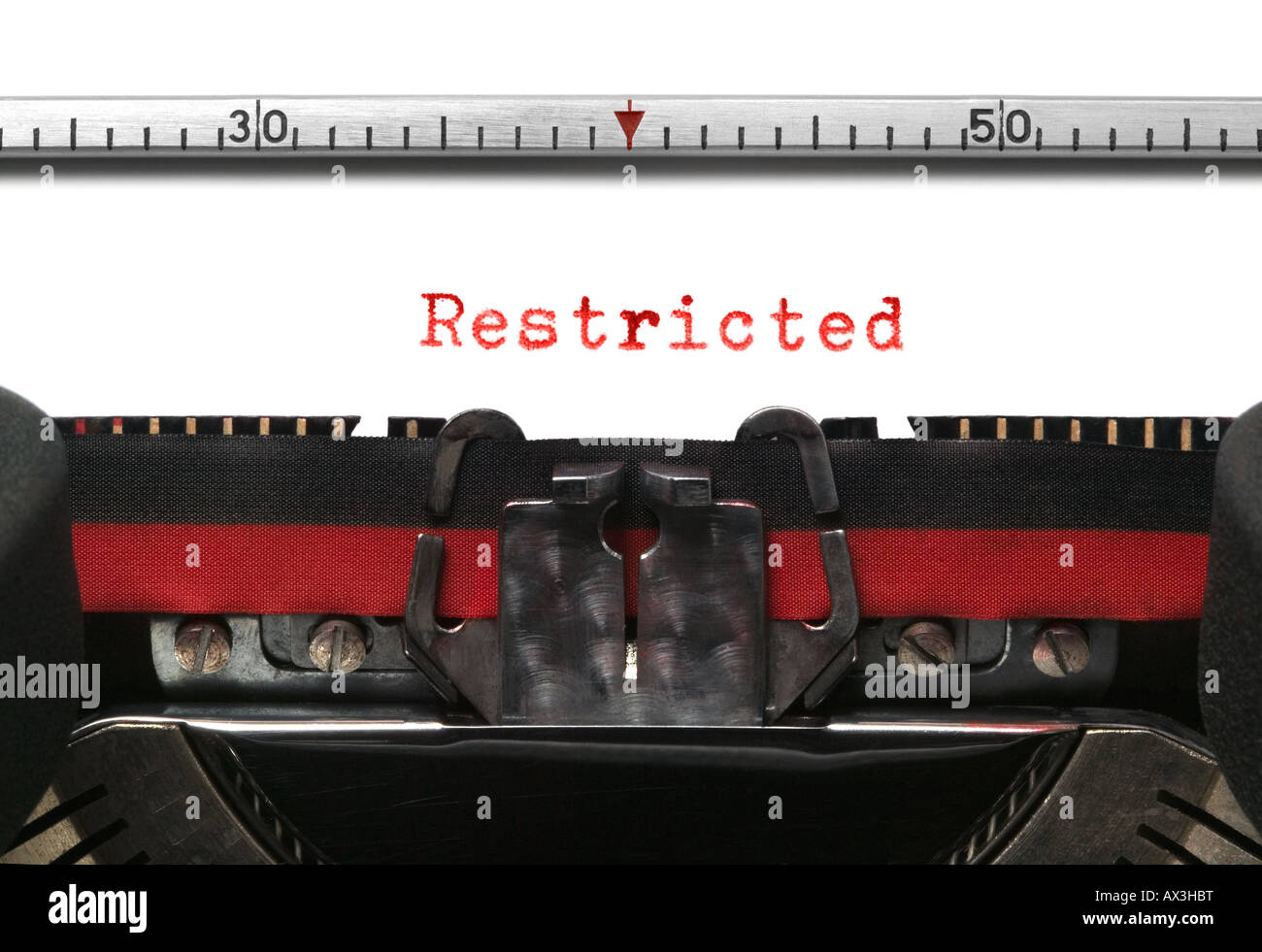 Restricted on an old typewriter in genuine red typescript - Stock Image