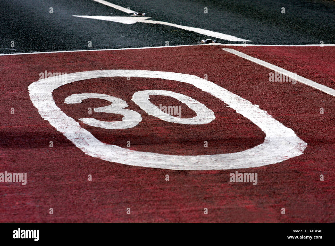 30 mph sign on road - Stock Image