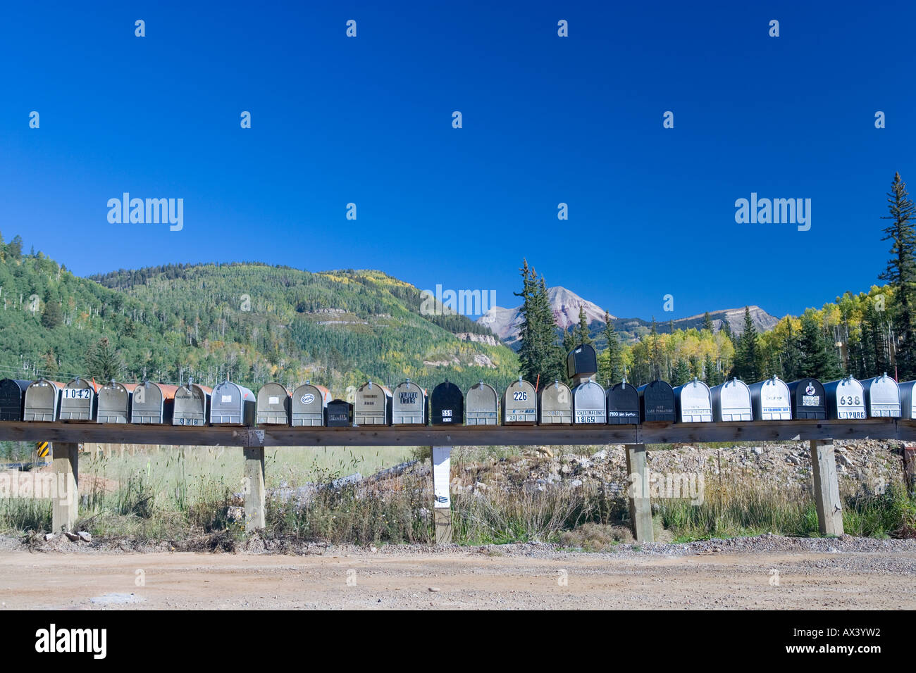 Row of postal mail boxes in rural Colorado, USA. - Stock Image