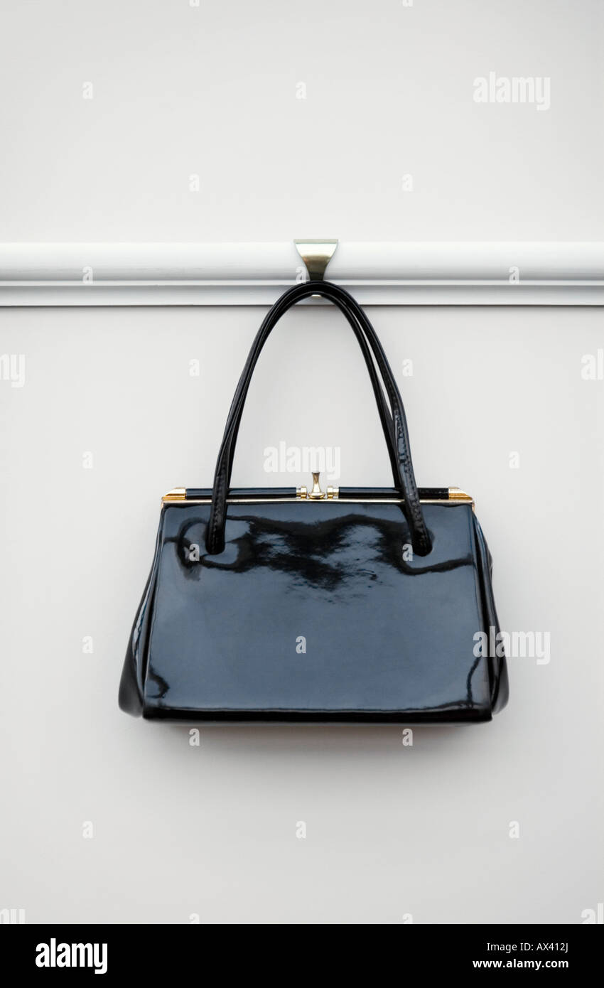 58f3fa28b1bd Vintage black patent 1950 s leather kelly style handbag - Stock Image