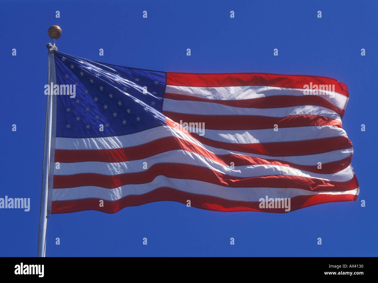 American flag flapping in breeze - Stock Image