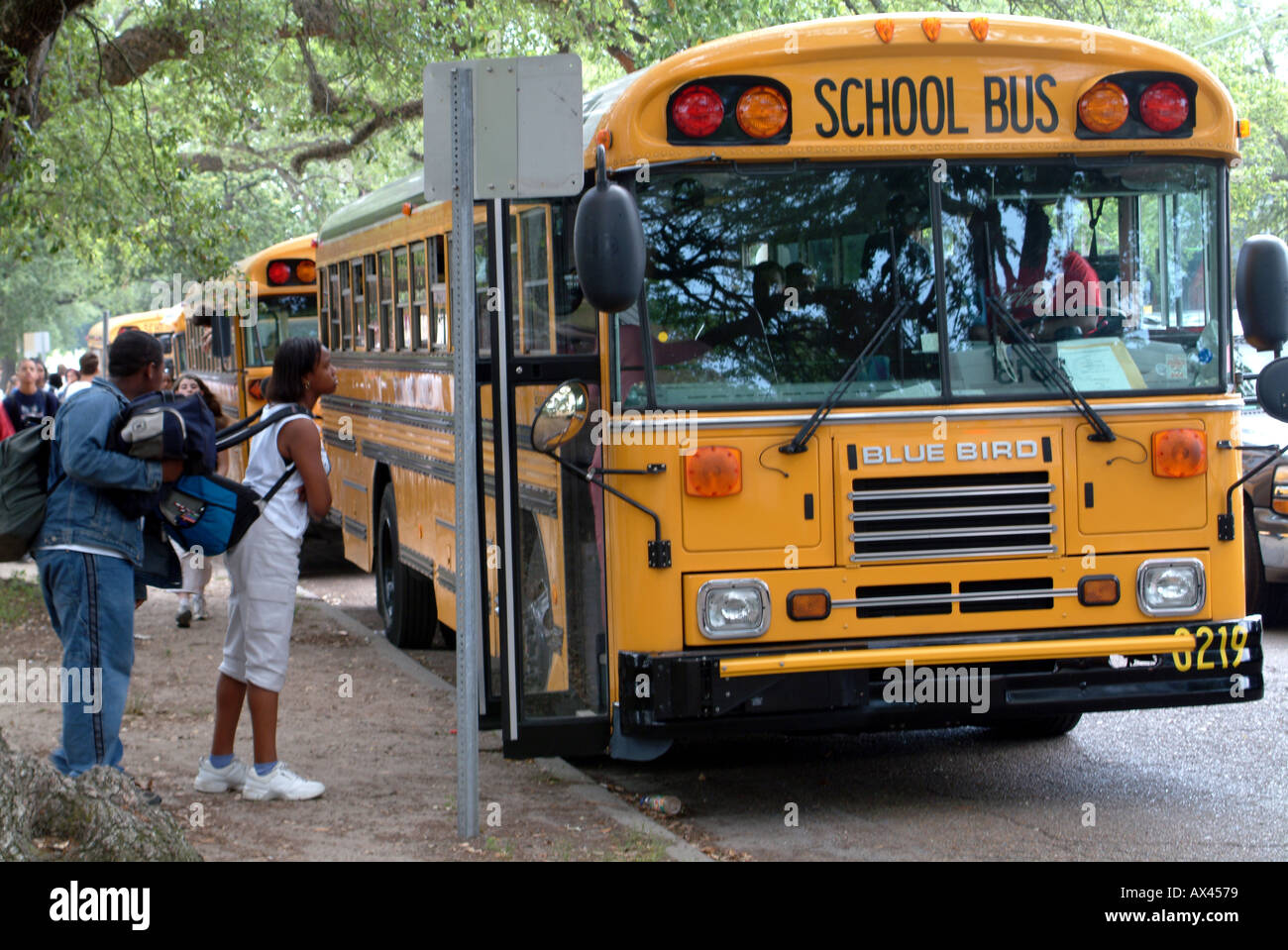 Students Boarding a Yellow School Bus USA United States of