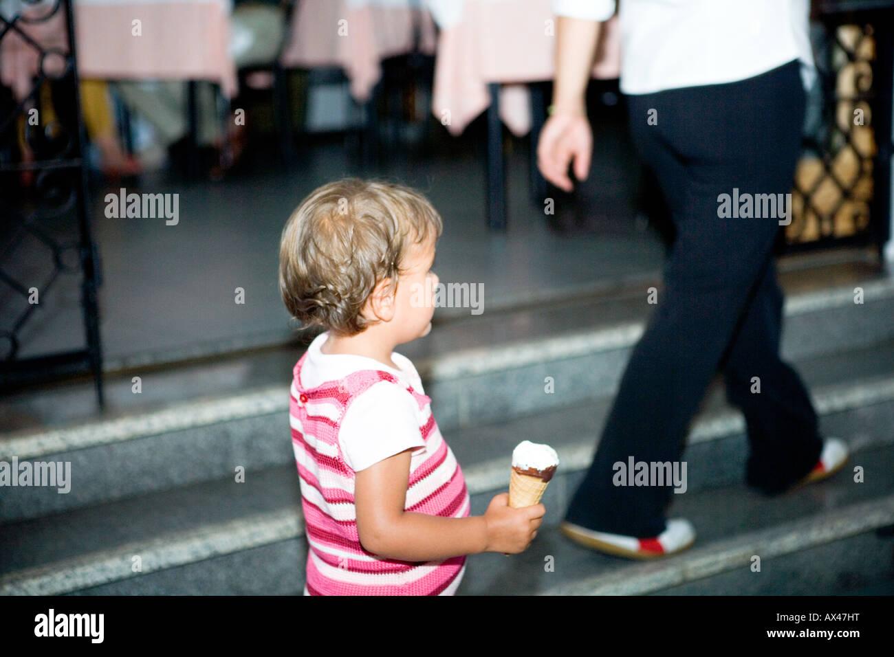 little child with icecream - Stock Image