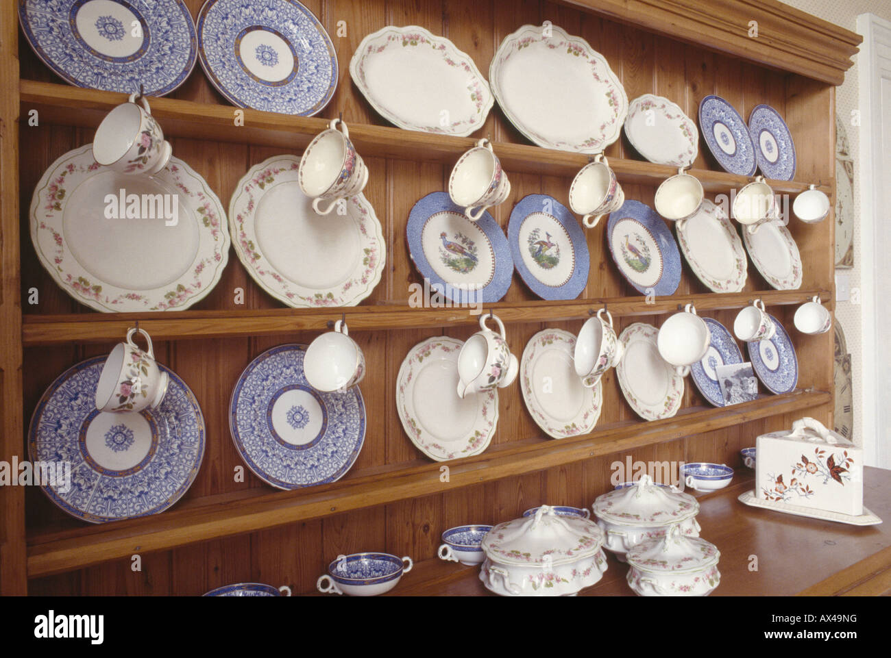 Collection of blue and white antique china plates and cups on wooden dresser & Collection of blue and white antique china plates and cups on wooden ...