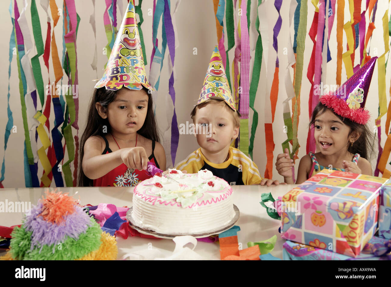Girl Cutting Cake In A Birthday Party