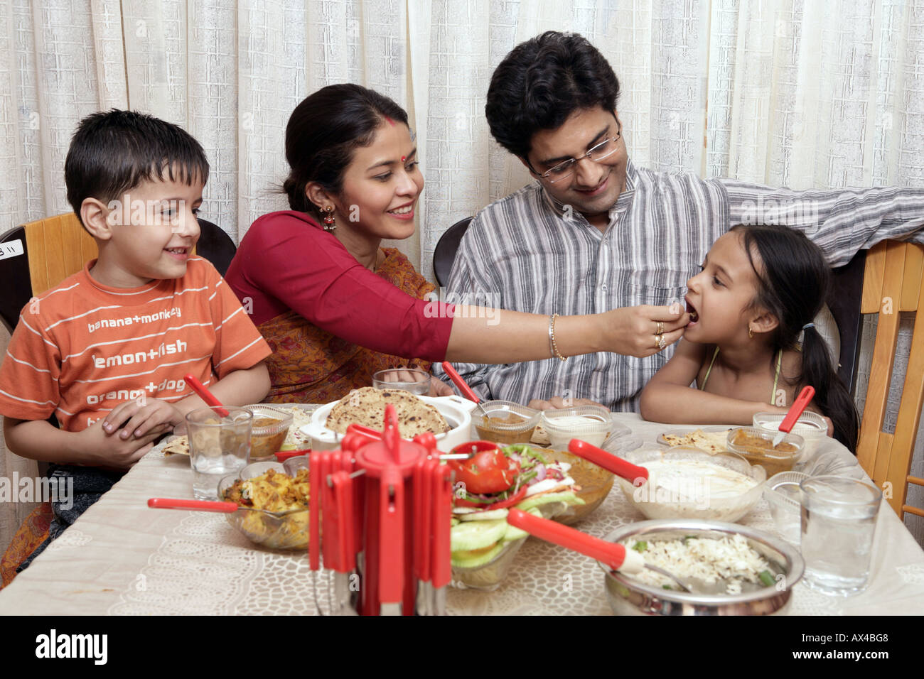 Family eating food at a dining table stock photo 9557063 for Best dining tables for families