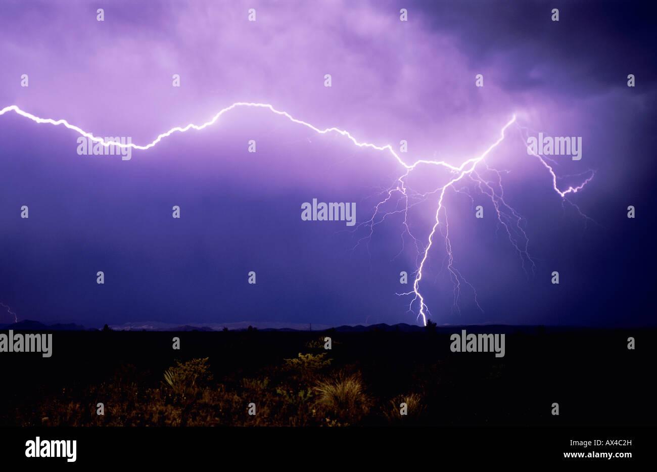 Lightning strike over desert Big Bend National Park Texas USA - Stock Image