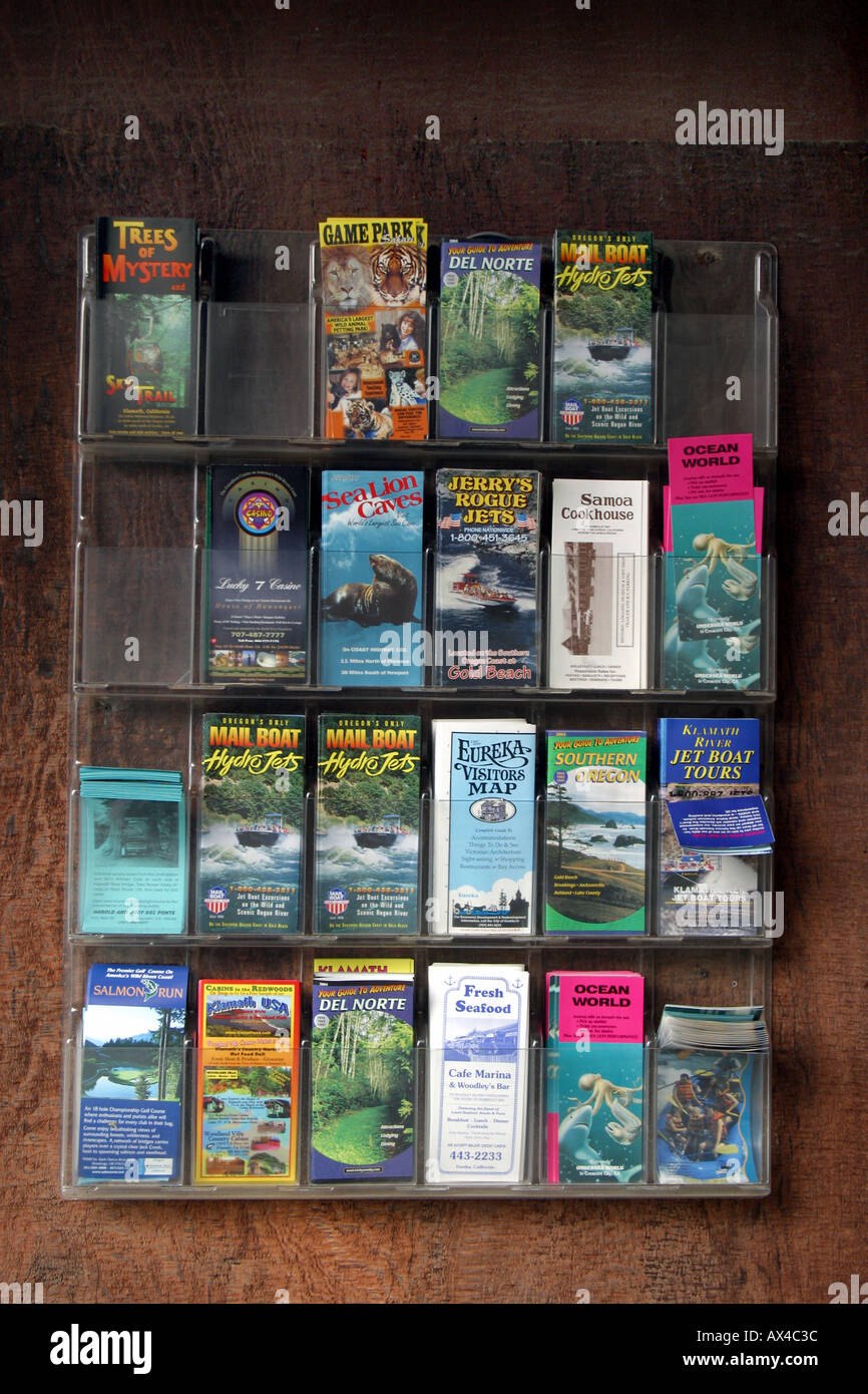 Tourist brochures in a rack at Trees of Mystery Klamath California - Stock Image