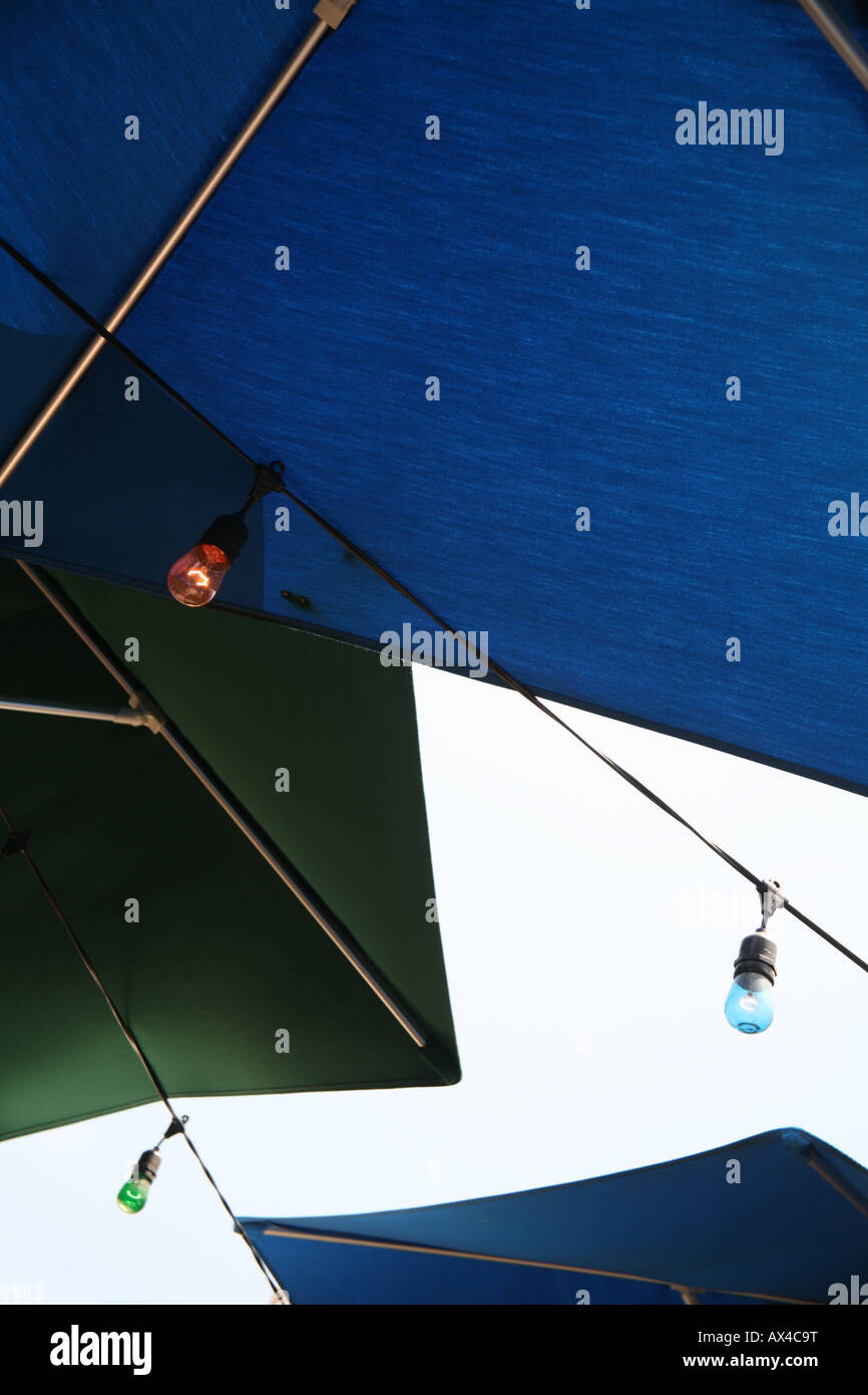Umbrellas and lights in outdoor restaurant Stock Photo