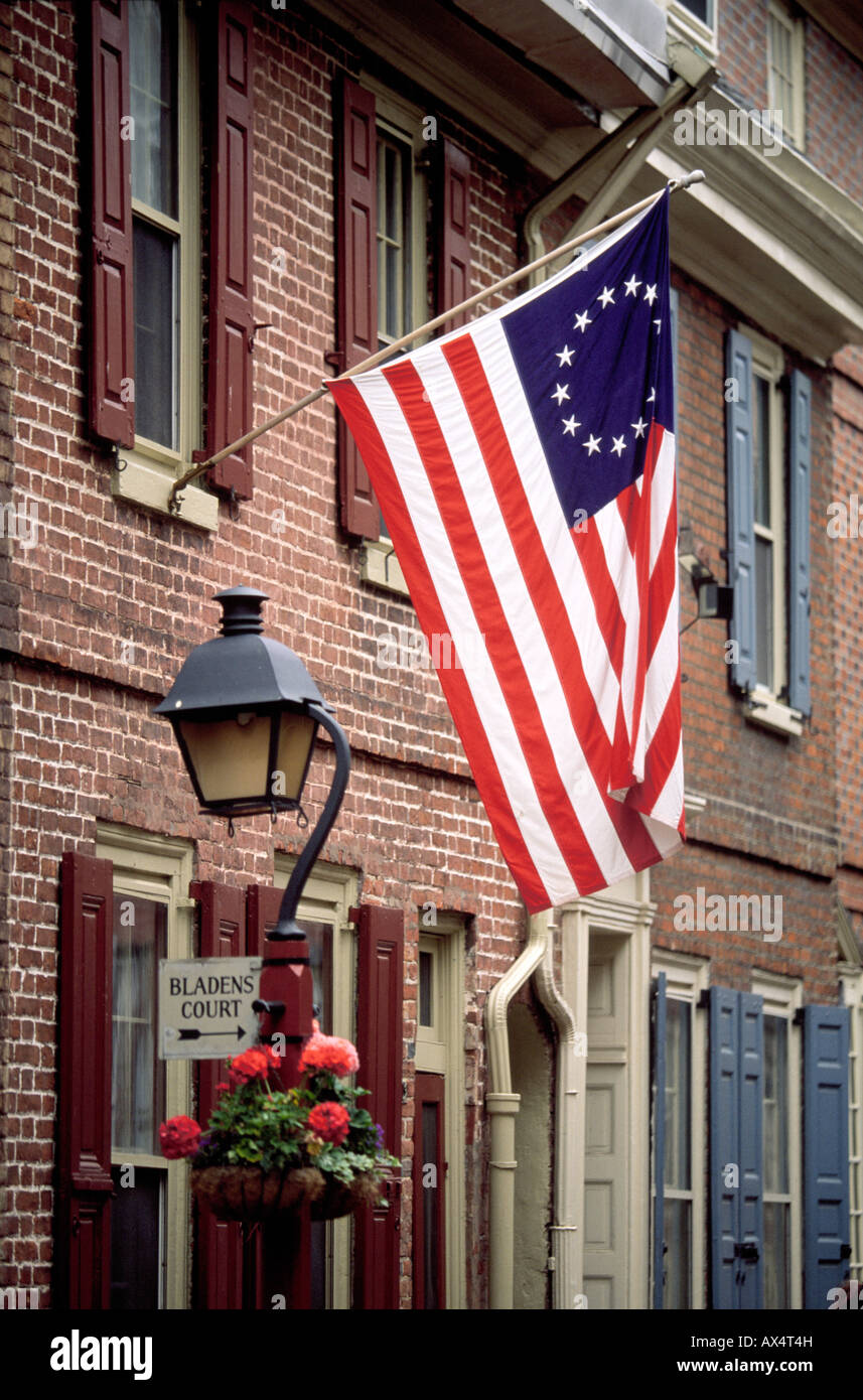 67582d1ff188 An American flag with a circle of 13 stars on a historic street in  Philadelphia -