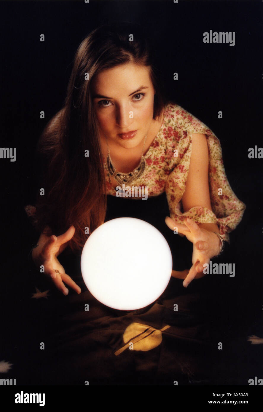 Fortune Teller with Crystal Ball - Stock Image