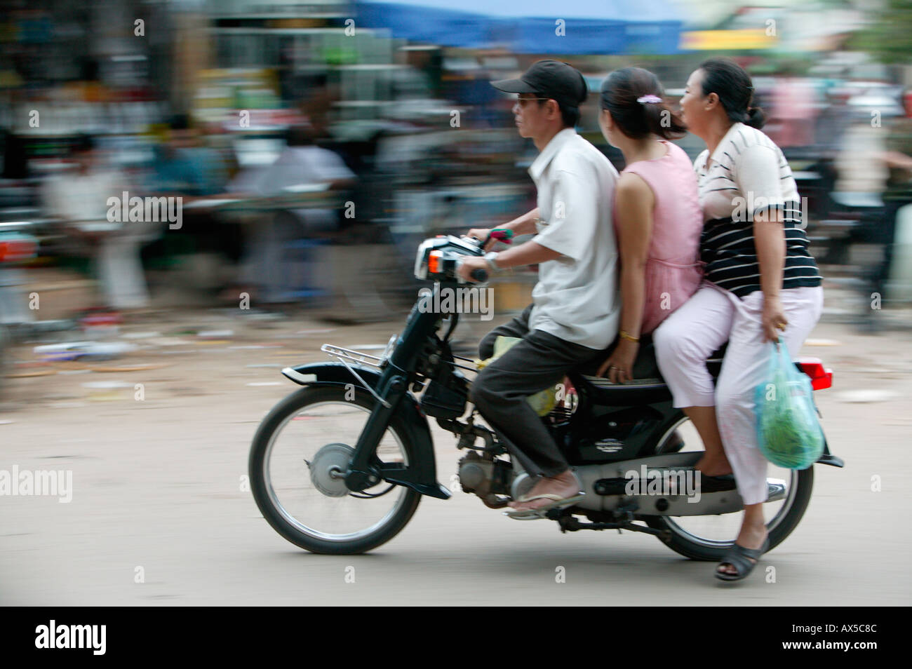 People on motorcycle Phnom Penh Cambodia Asia - Stock Image