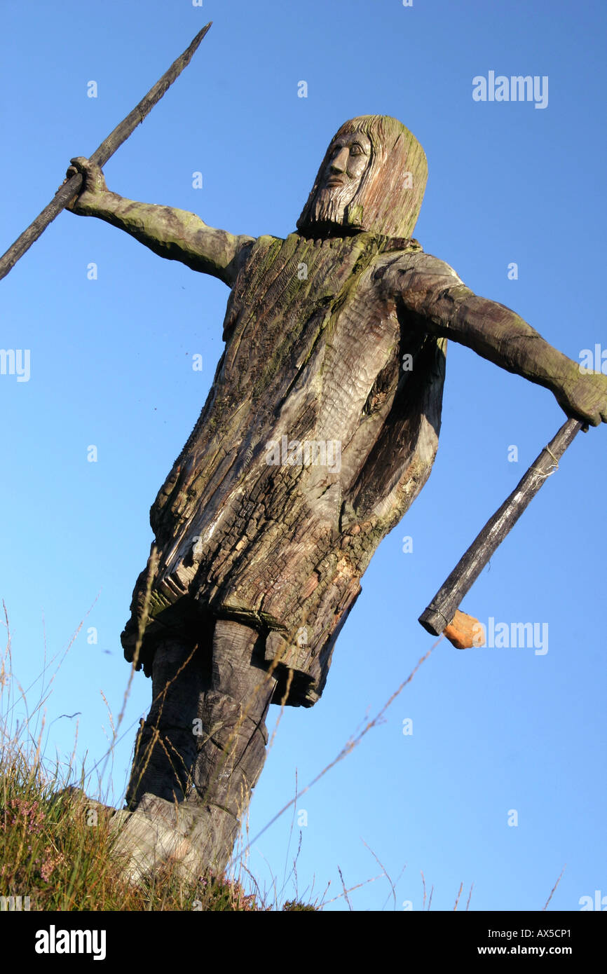 wooden carving of caveman, Ballycastle, County Antrim, Northern Ireland - Stock Image