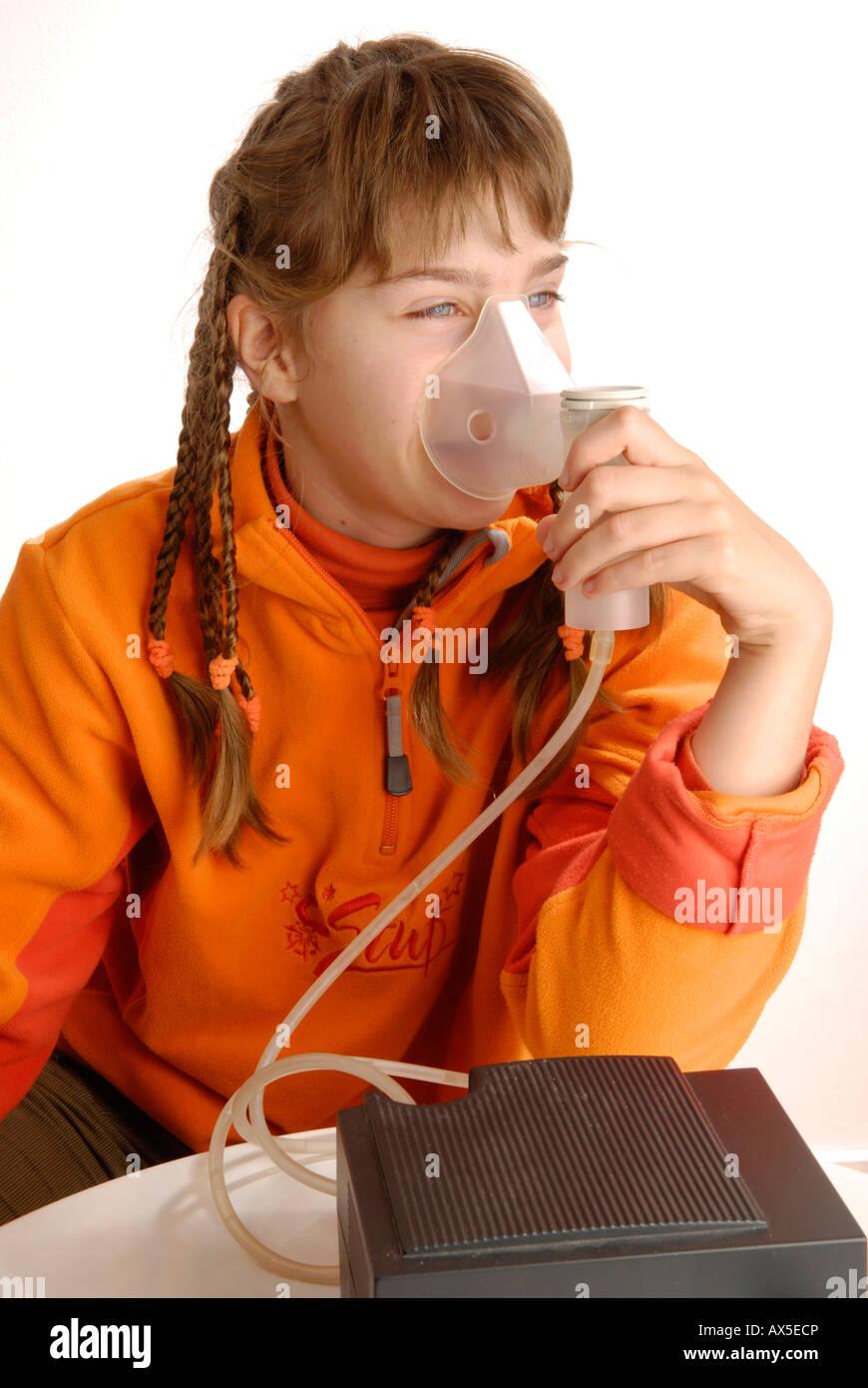 Girl using inhaler Stock Photo