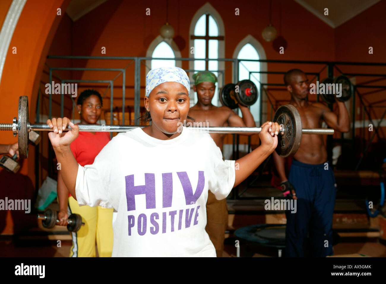 Young woman working out at a church that's been converted into a gym, Capetown, South Africa, Africa - Stock Image