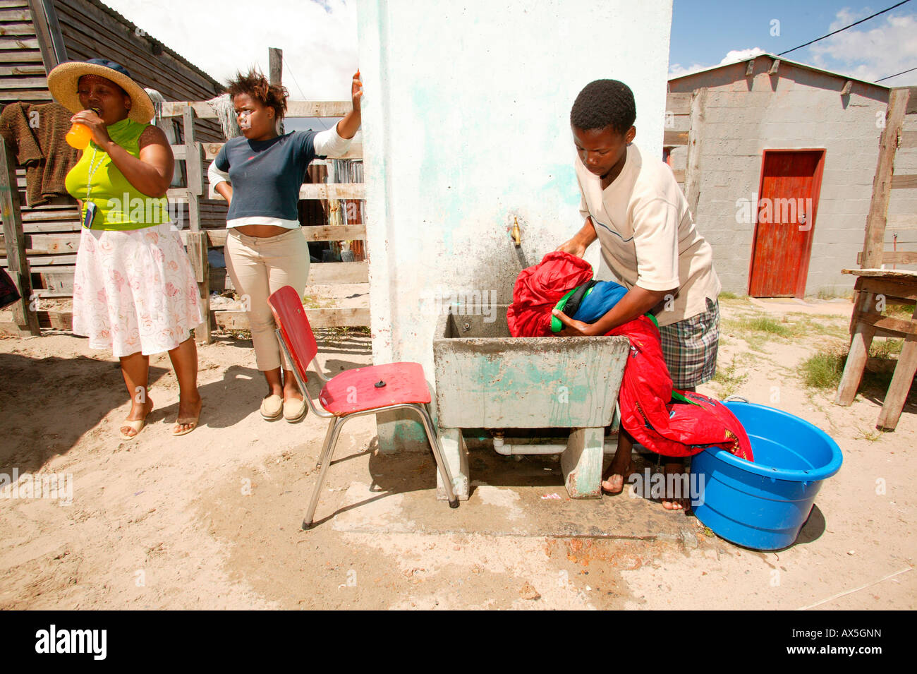 Young man doing laundry, Capetown, South Africa, Africa - Stock Image