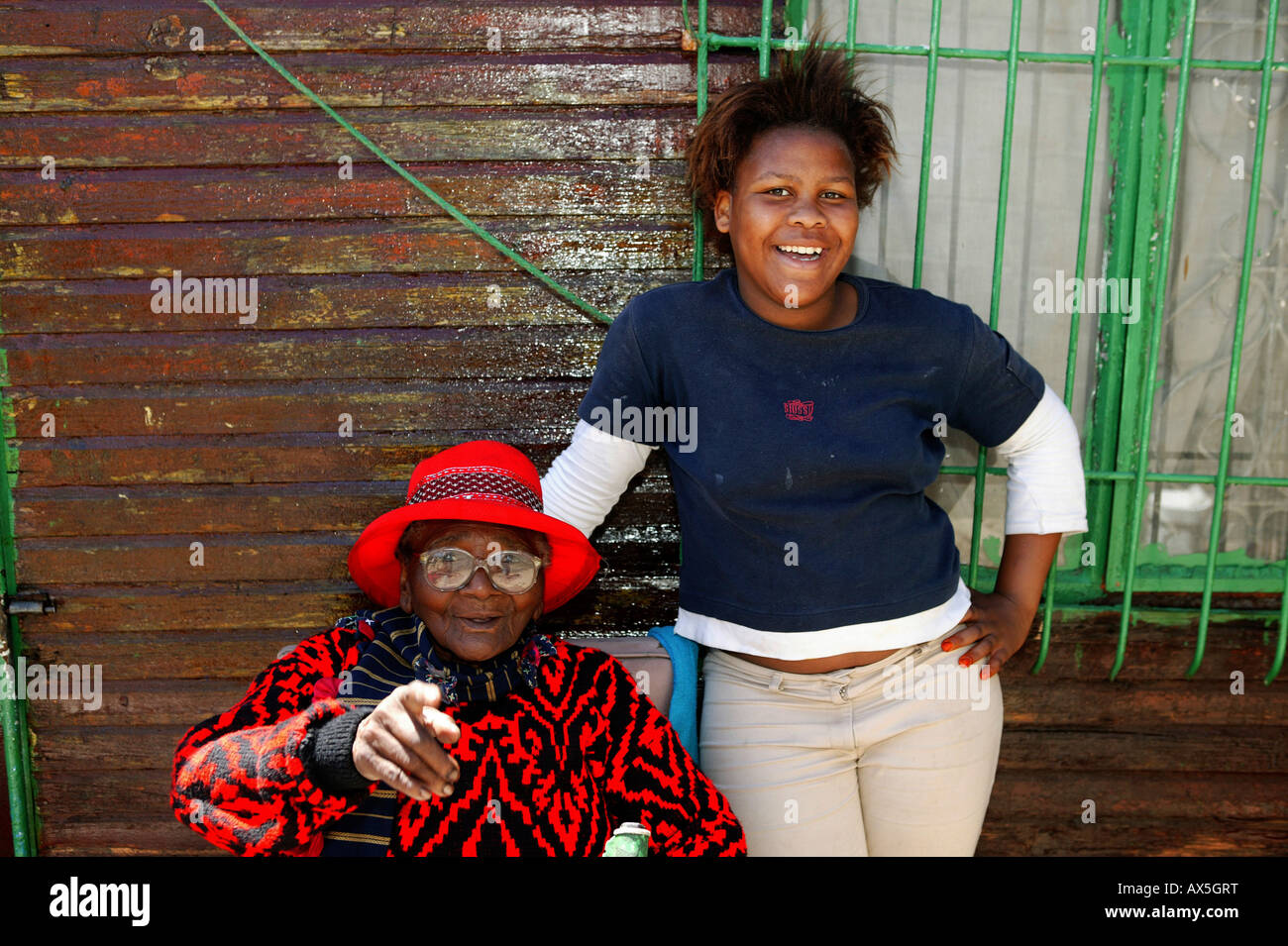Elderly woman wearing glasses posing with her granddaughter, Capetown, South Africa, Africa - Stock Image